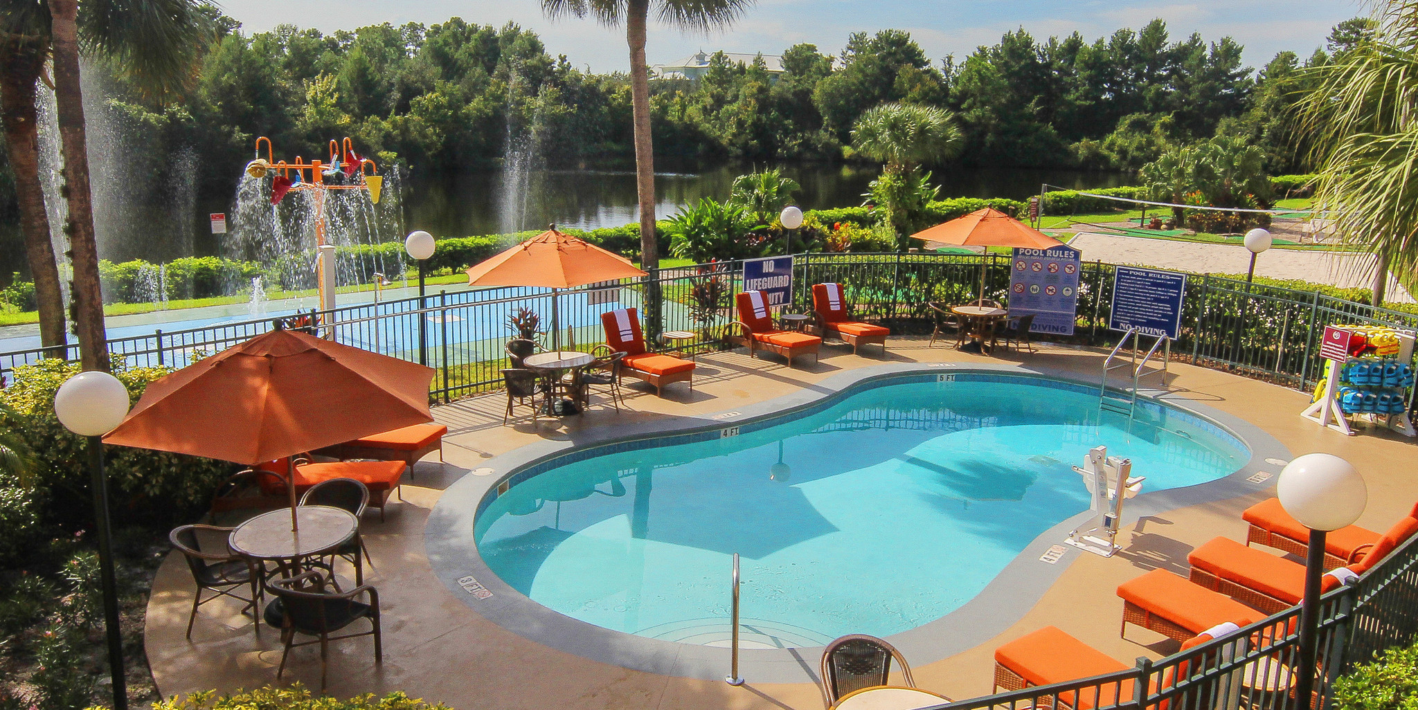 Heated Outdoor Pool With Poolside Tables And Lounge Chairs Westgate Leisure Resort