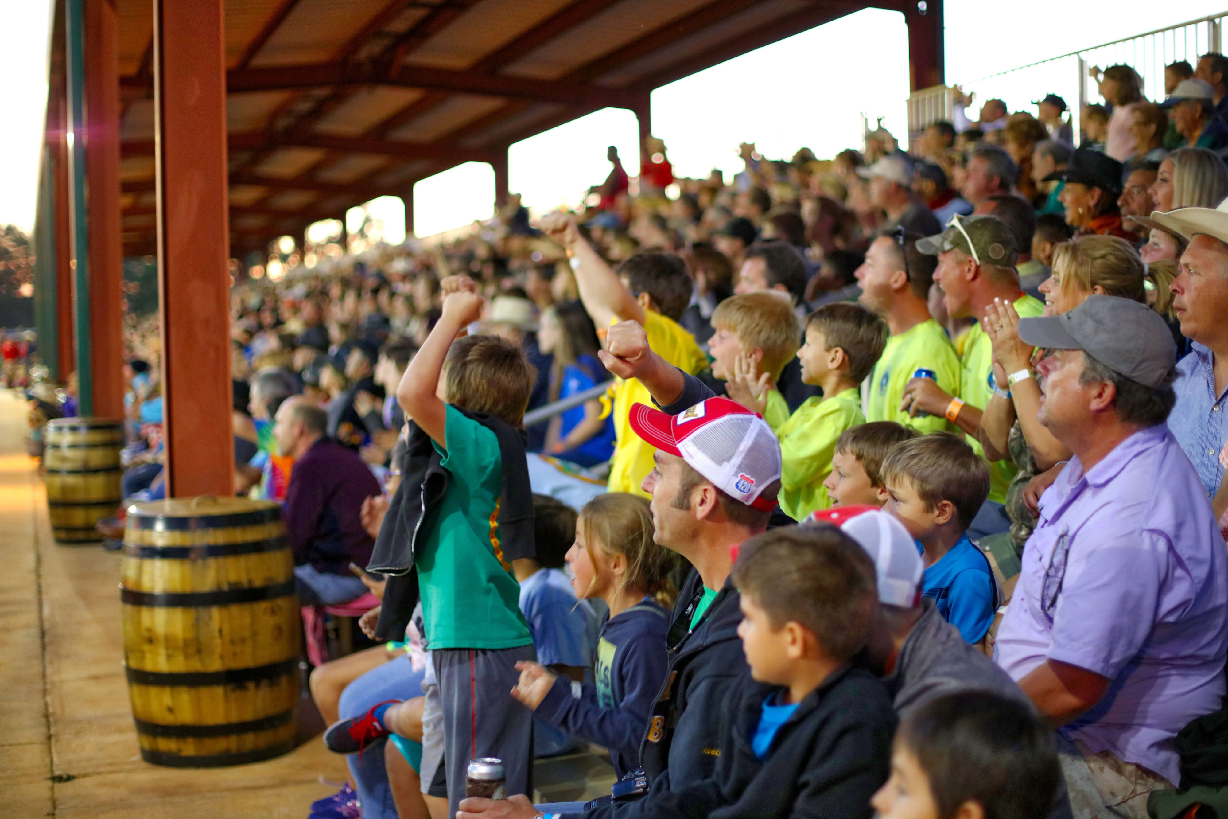Families cheering at Championship Rodeo | Westgate River Ranch Resort & Rodeo | Westgate Resorts