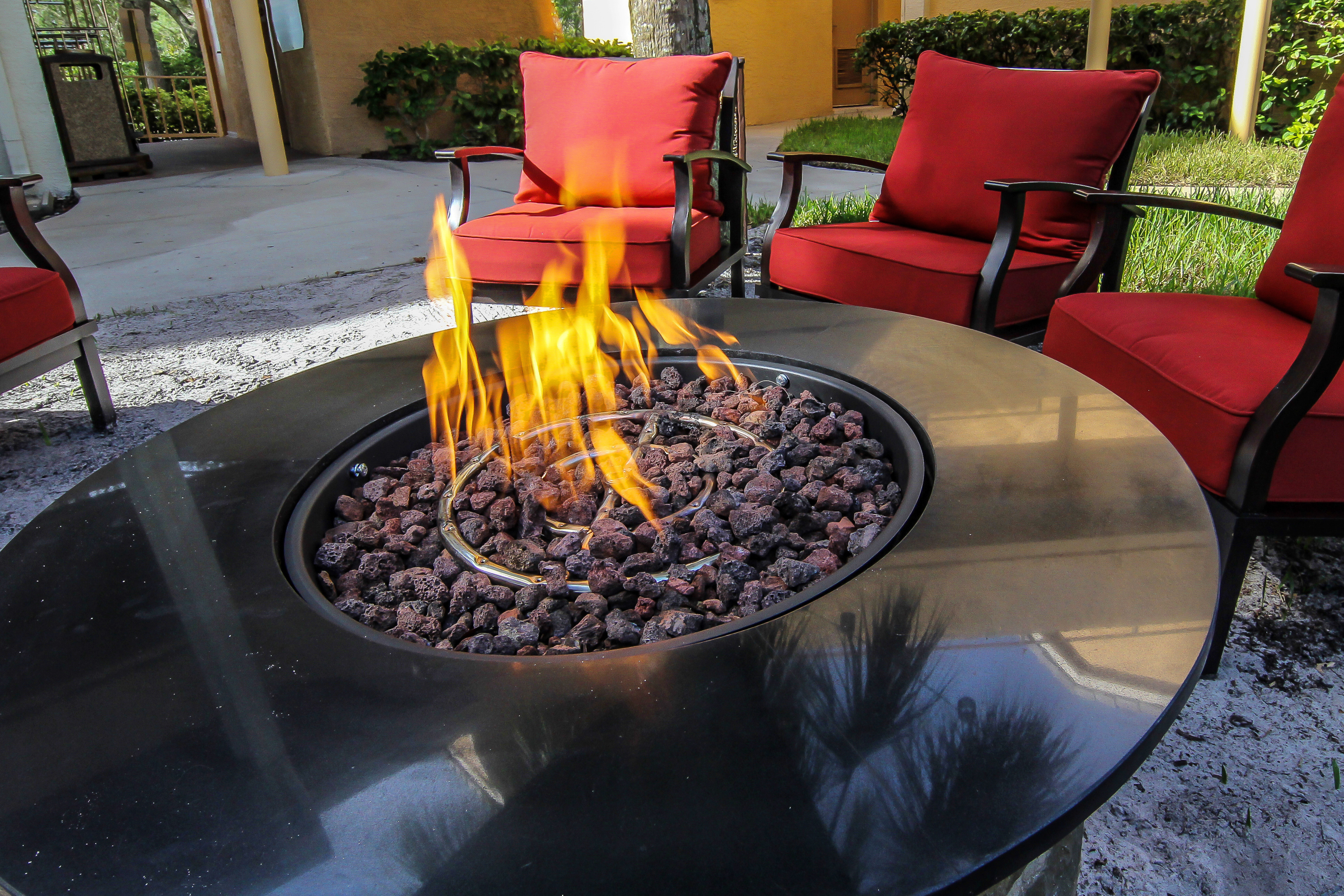 Fire Pit surrounded by chairs at one of our leisure hotels next to Seaworld Orlando | Westgate Leisure Resort | Westgate Resorts