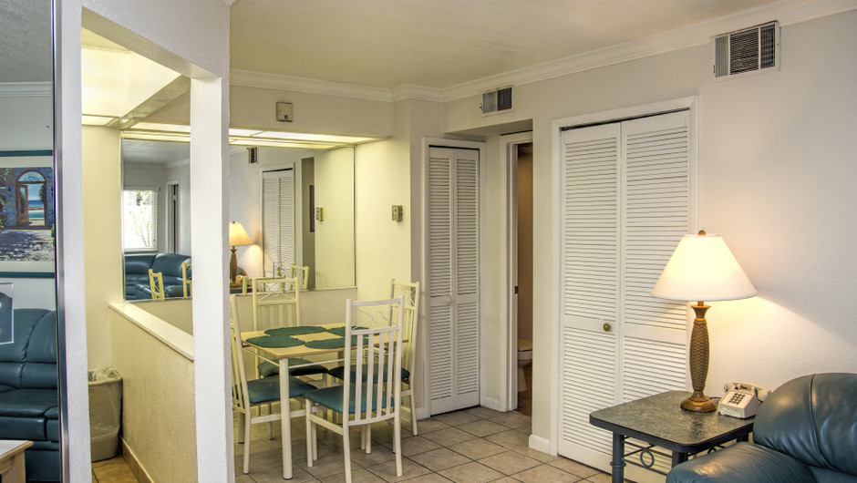 Club Orlando one-bedroom villa features a fully equipped kitchen, guest bathroom with walk-in shower and separate dining area | Club Orlando | Westgate Resorts