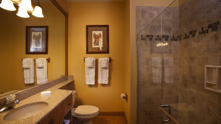 Bathroom in Saddle Club One-Bedroom Grand Cabin |  Westgate River Ranch Resort & Rodeo | Westgate Resorts