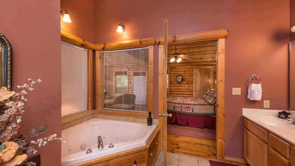 Bed in Two-Bedroom Cabin in Branson Missouri Hotel | Westgate Branson Woods Resort | Westgate Resorts