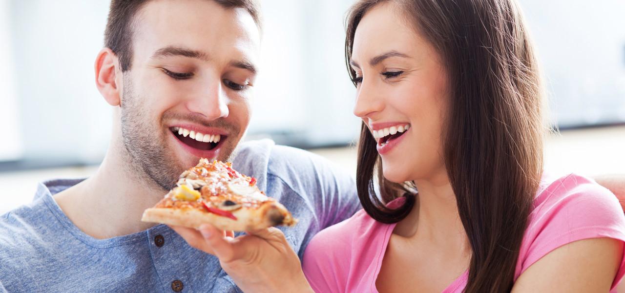 Couple Enjoying Pizza | Westgate Lakes Resort & Spa | Orlando, FL | Westgate Resorts