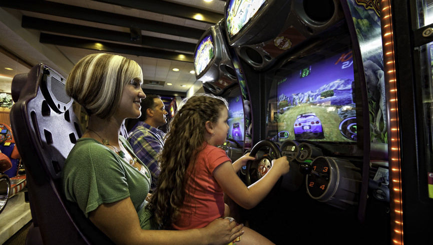Mother and Daughter Playing Video Arcade Game | Westgate Lakes Resort & Spa | Orlando, FL | Westgate Resorts