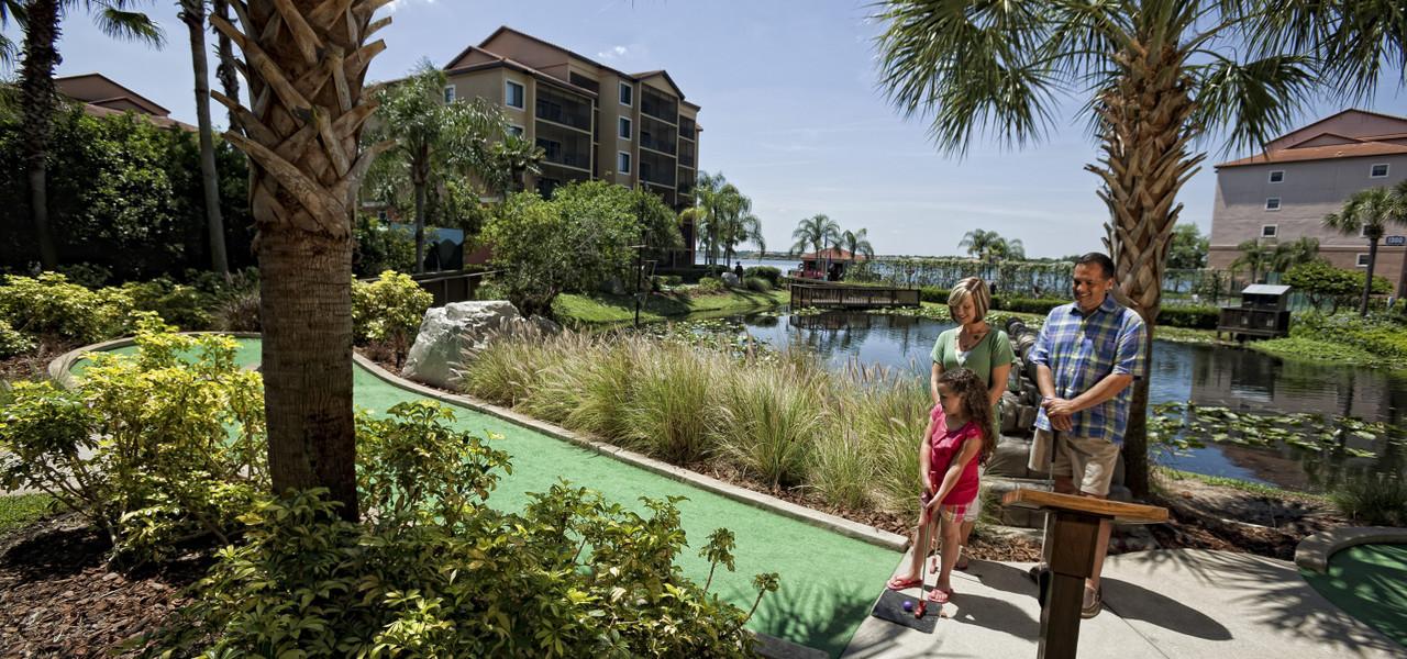 Family Playing Miniature Golf | Westgate Lakes Resort & Spa | Orlando, FL | Westgate Resorts