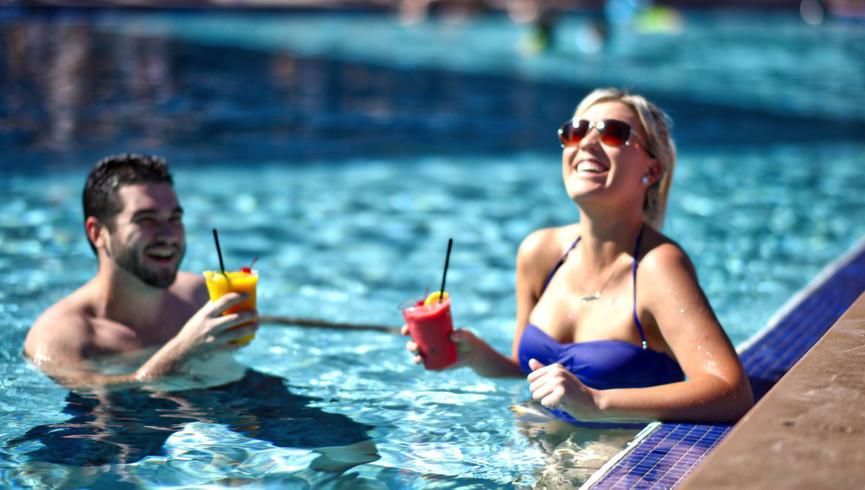 Couple Enjoying the Pool | Westgate Palace Resort | Orlando, FL | Westgate Resorts