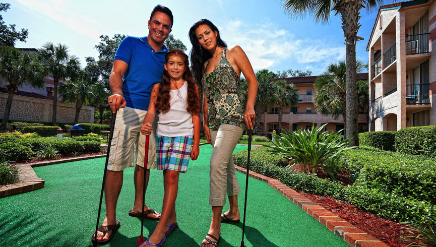 Family on miniature golf course at our Orlando resorts | Westgate Blue Tree Resort | Westgate Resorts Orlando