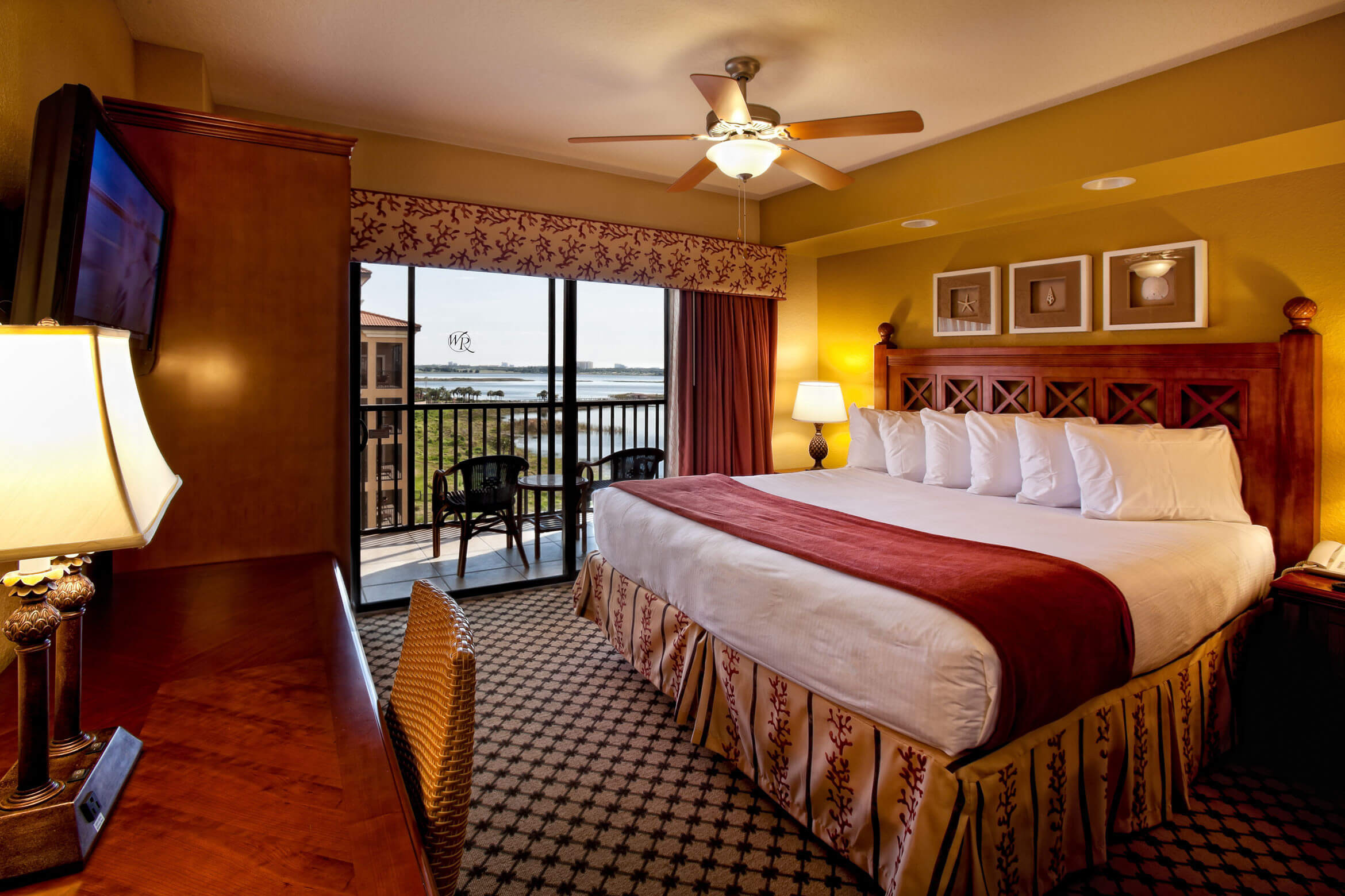 Bedroom with King Bed and Screened Balcony | Westgate Lakes Resort & Spa | Orlando, FL | Westgate Resorts