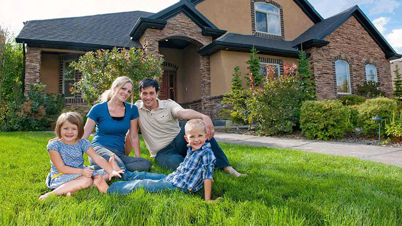 Family in Front of Home | Taking Control of Family Finances | New Year's Resolutions For Your Kids and You!