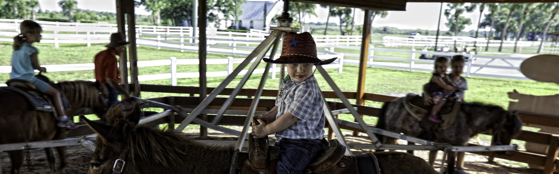 Kids ages 7 and younger can ride a gentle pony in live merry-go-round that moves our ponies and mules in small circles for an easy and smooth ride. Located inside the Petting Farm at Westgate River Ranch Resort & Rodeo in Florida.