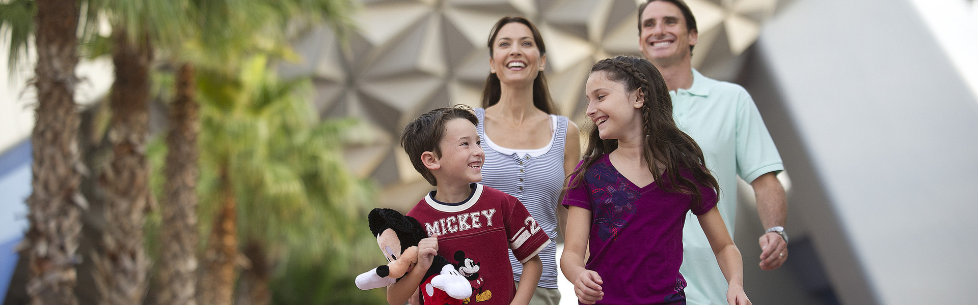 Family enjoying Disney World Orlando with their park tickets discount after receiving attraction tickets and Orlando park deals from Tickets To You!