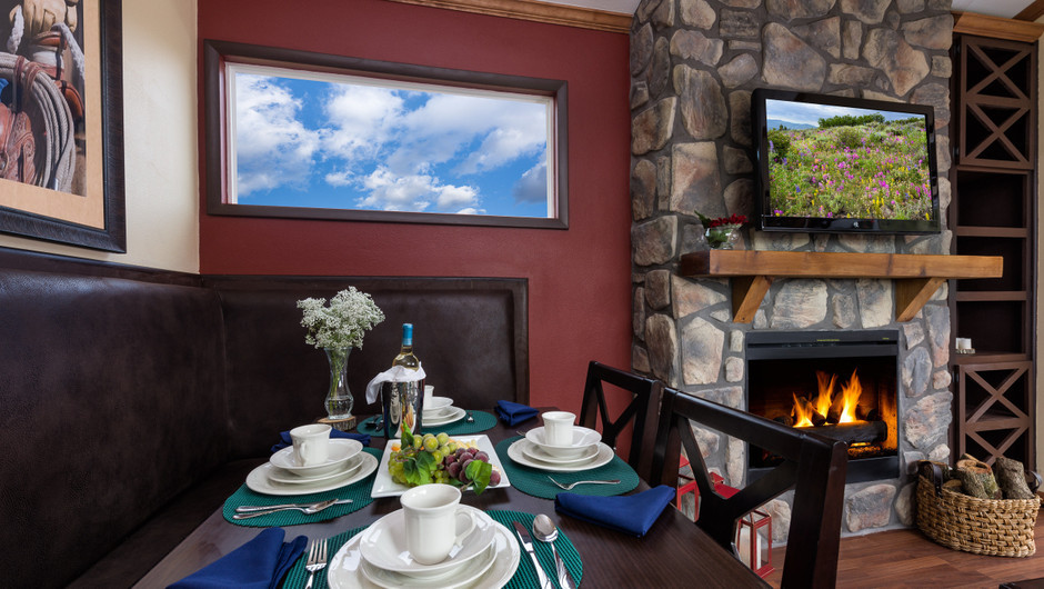 Fireplace in Saddle Club Rail Car Room |  Westgate River Ranch Resort & Rodeo | Westgate Resorts