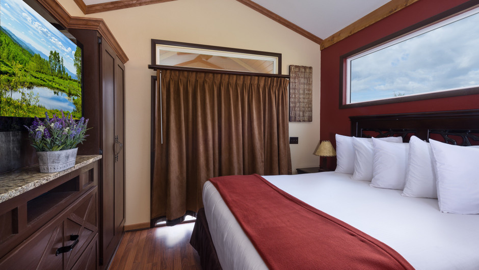 Bed in Saddle Club Rail Car Room |  Westgate River Ranch Resort & Rodeo | Westgate Resorts