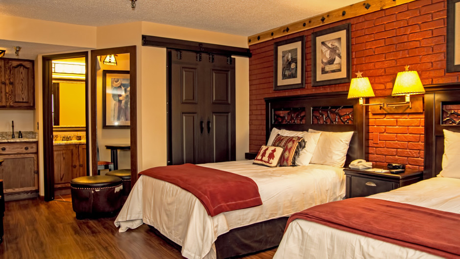 Bed in Lodge Guest Room |  Westgate River Ranch Resort & Rodeo | Westgate Resorts