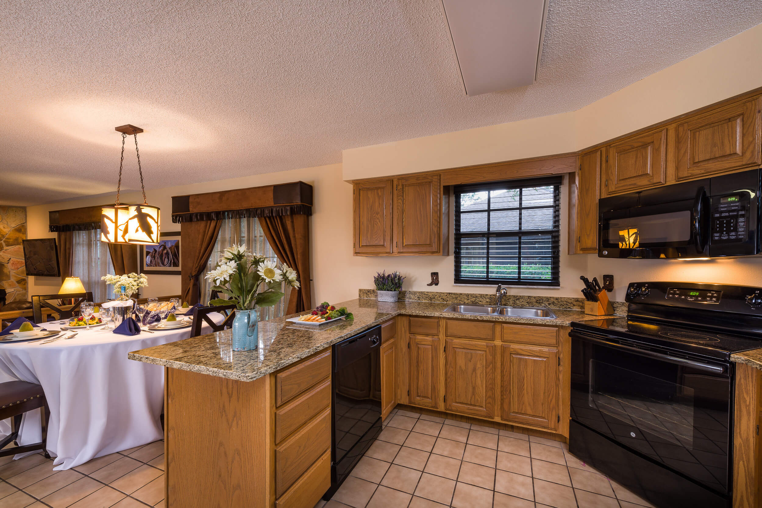 Kitchen in Lodge Two-Bedroom Cottage |  Westgate River Ranch Resort & Rodeo | Westgate Resorts
