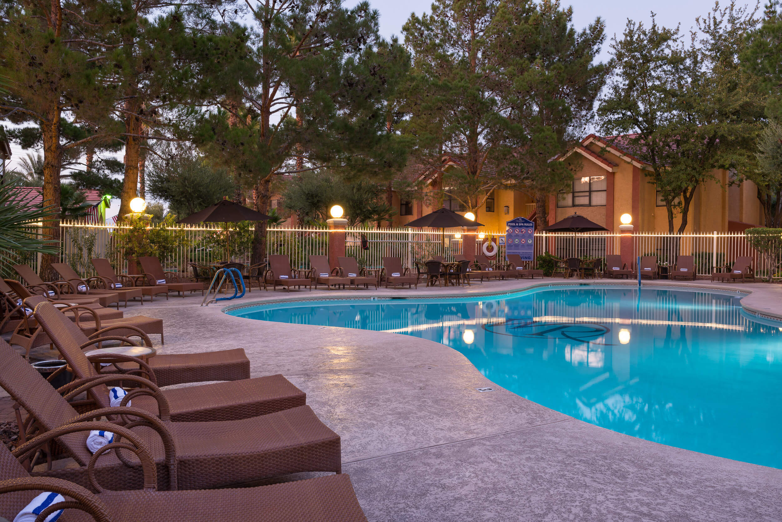 Heated outdoor pool and hot tub surrounded by lounge chairs at Westgate's Las Vegas Flamingo Resort | Westgate Flamingo Bay Resort | Westgate Resorts