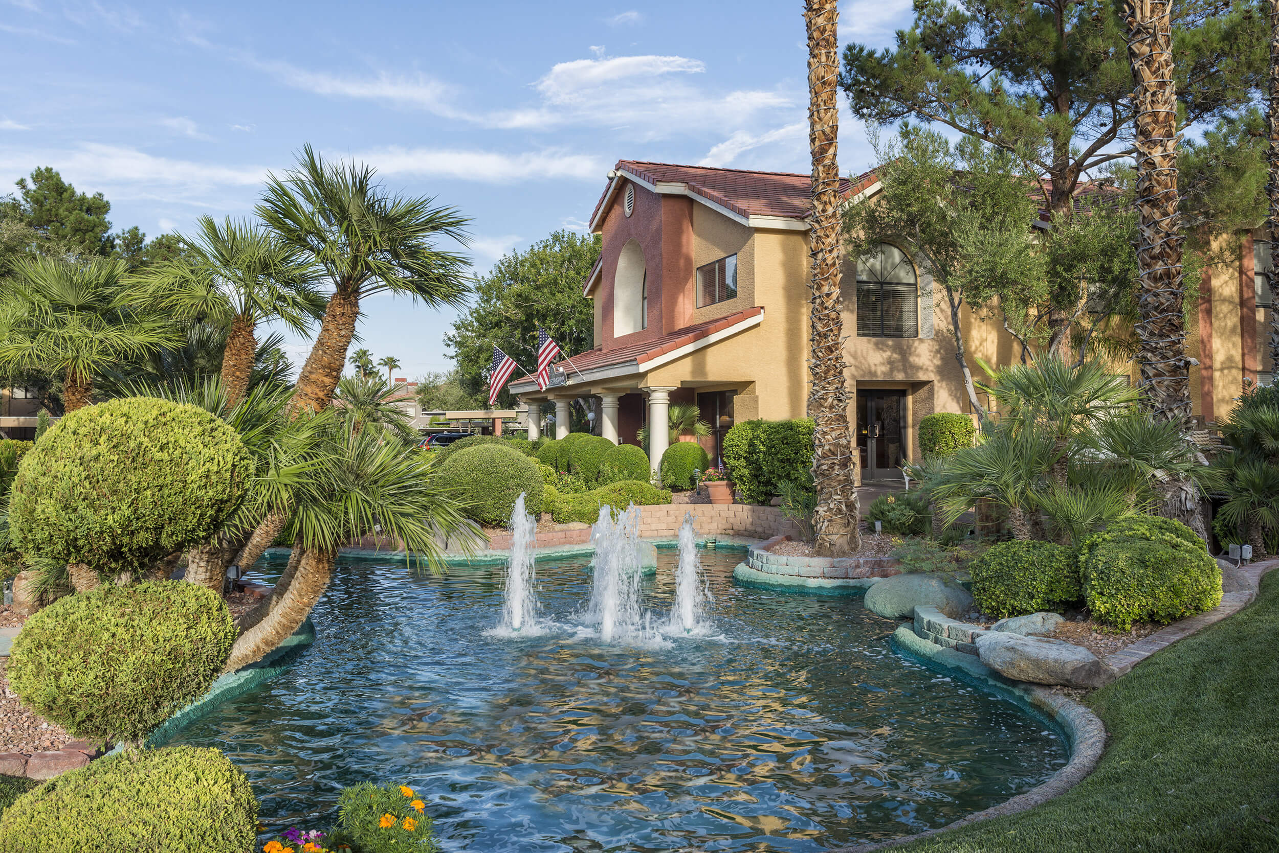 Tropically landscaped resort with pond and fountain | Westgate Flamingo Bay Resort