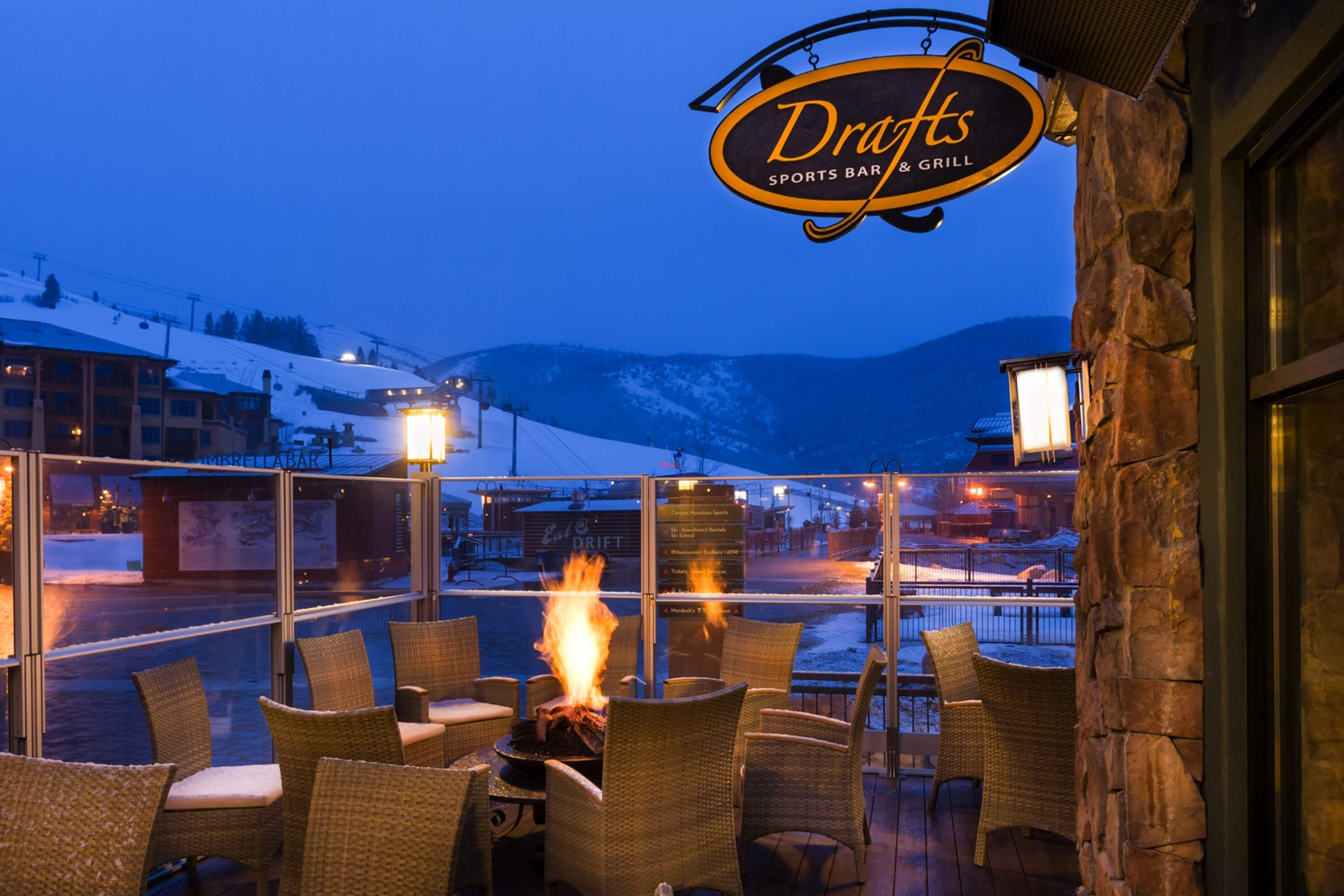 Outdoor area of sports bar with fireplace overlooking ski slopes | Westgate Park City Resort & Spa
