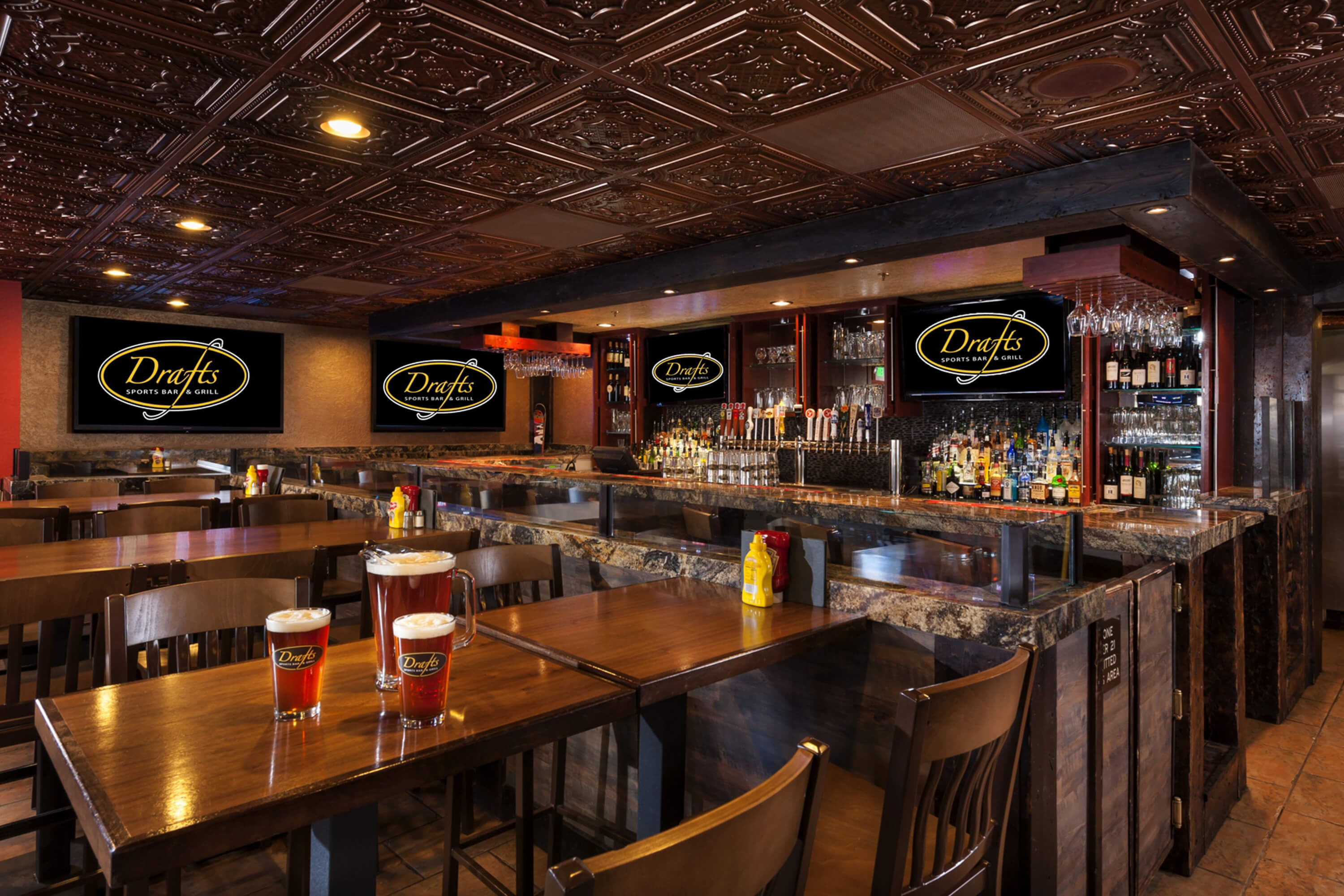 Draft beer on table with full bar in backaground | Westgate Park City Resort & Spa