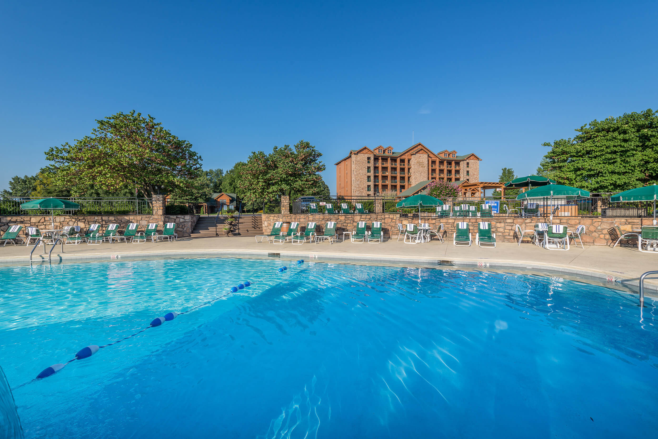 Outdoor Pool with resort building in background | Westgate Branson Woods Resort