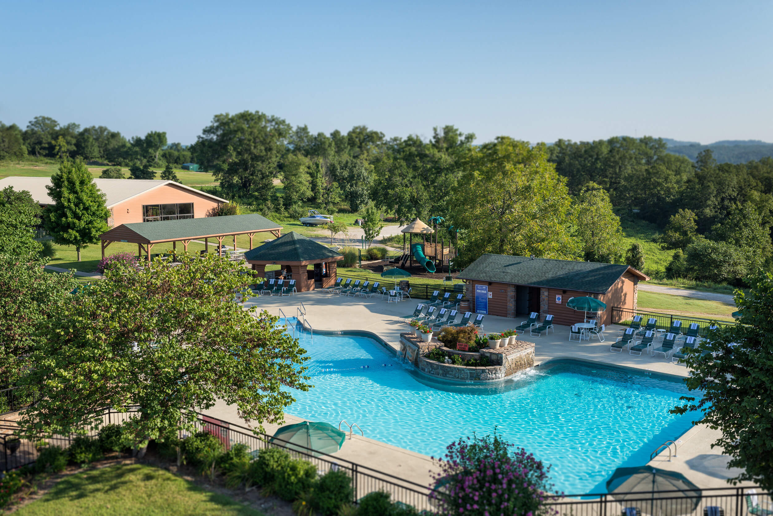 Outdoor pool with waterfall and lounge chairs | Westgate Branson Woods Resort