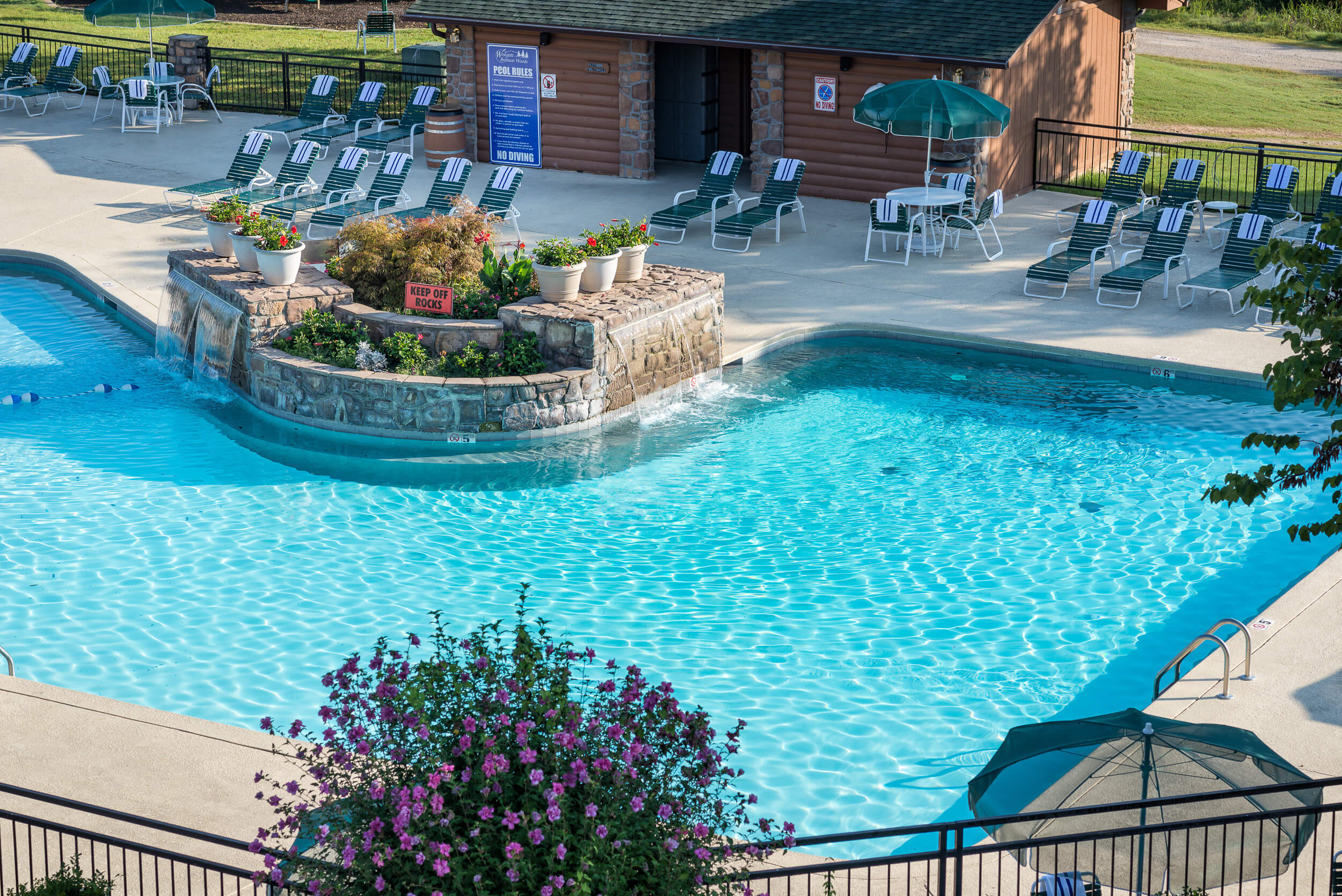 Outdoor pool with rock waterfall | Westgate Branson Woods Resort | Westgate Resorts