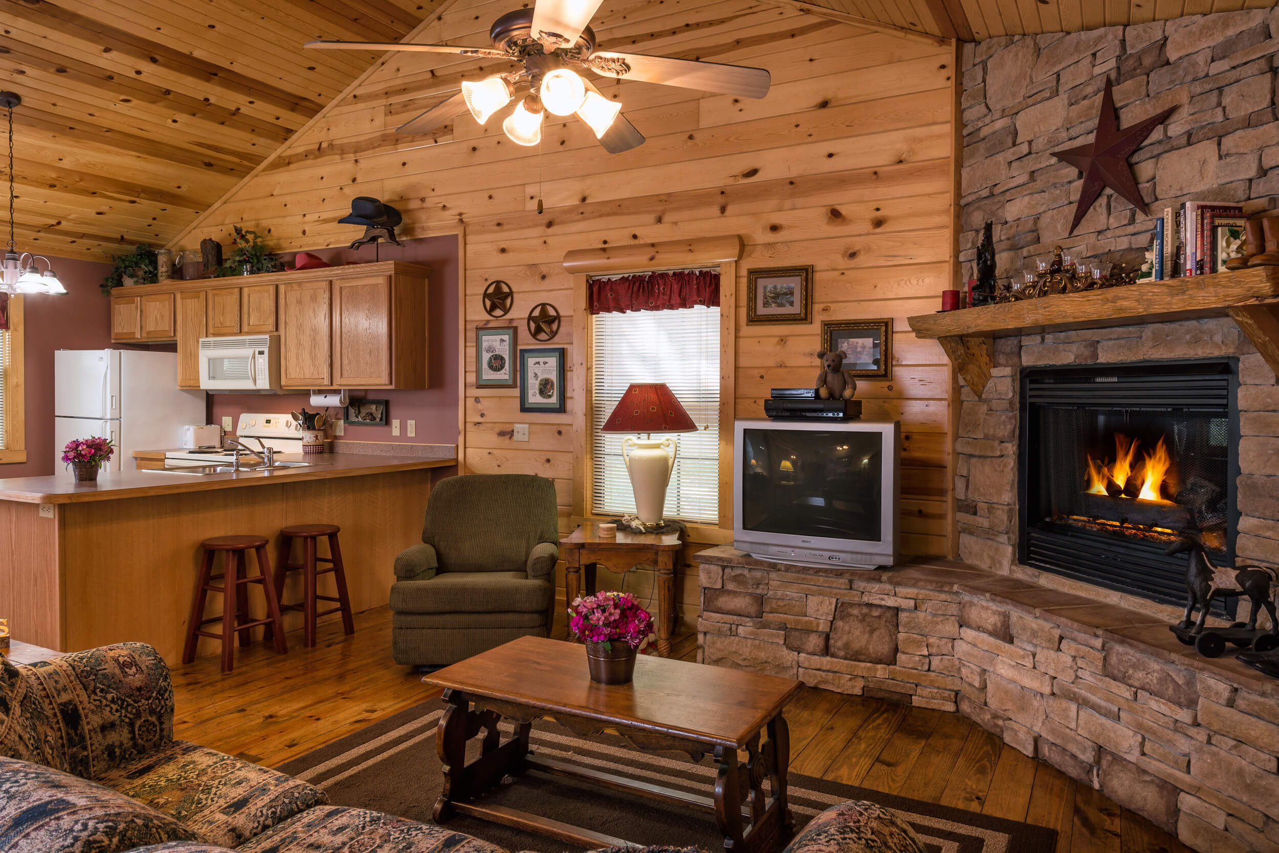 Living area with fireplace in Two-Bedroom Cabin | Westgate Branson Woods Resort