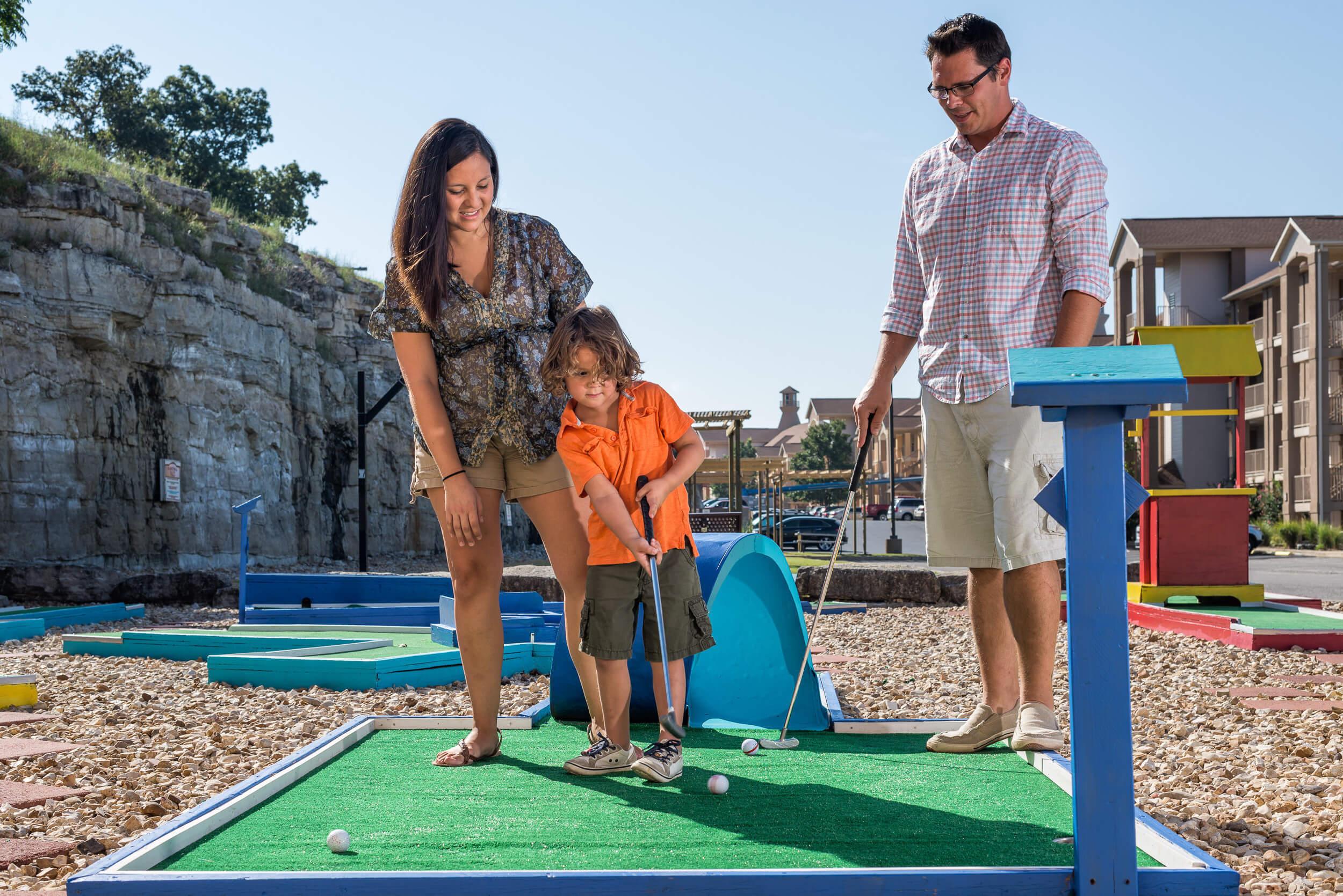 Family playing mini golf at resort | Westgate Branson Lakes Resort