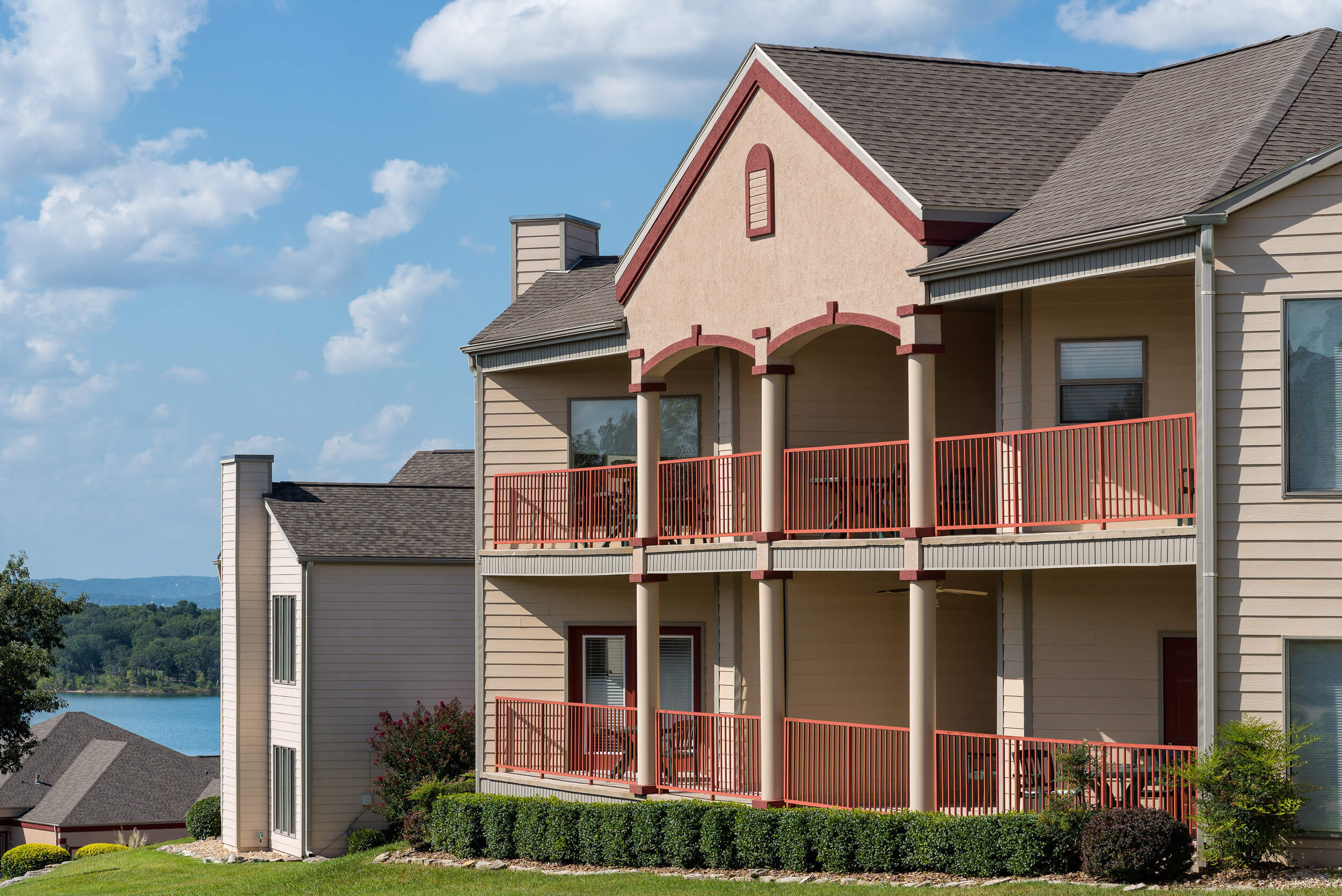 Resort exterior with villas and private balconies overlooking Table Rock Lake | Westgate Branson Lakes Resort
