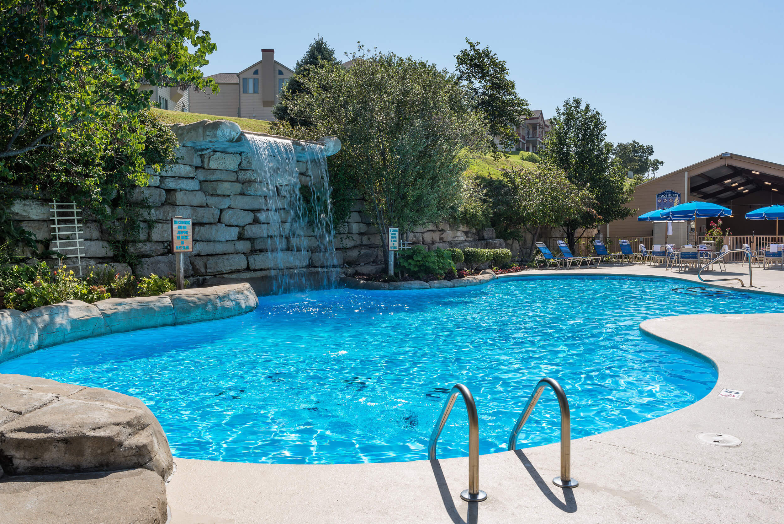 Heated outdoor pool with waterfall | Westgate Branson Lakes Resort | Westgate Family Resorts in Missouri