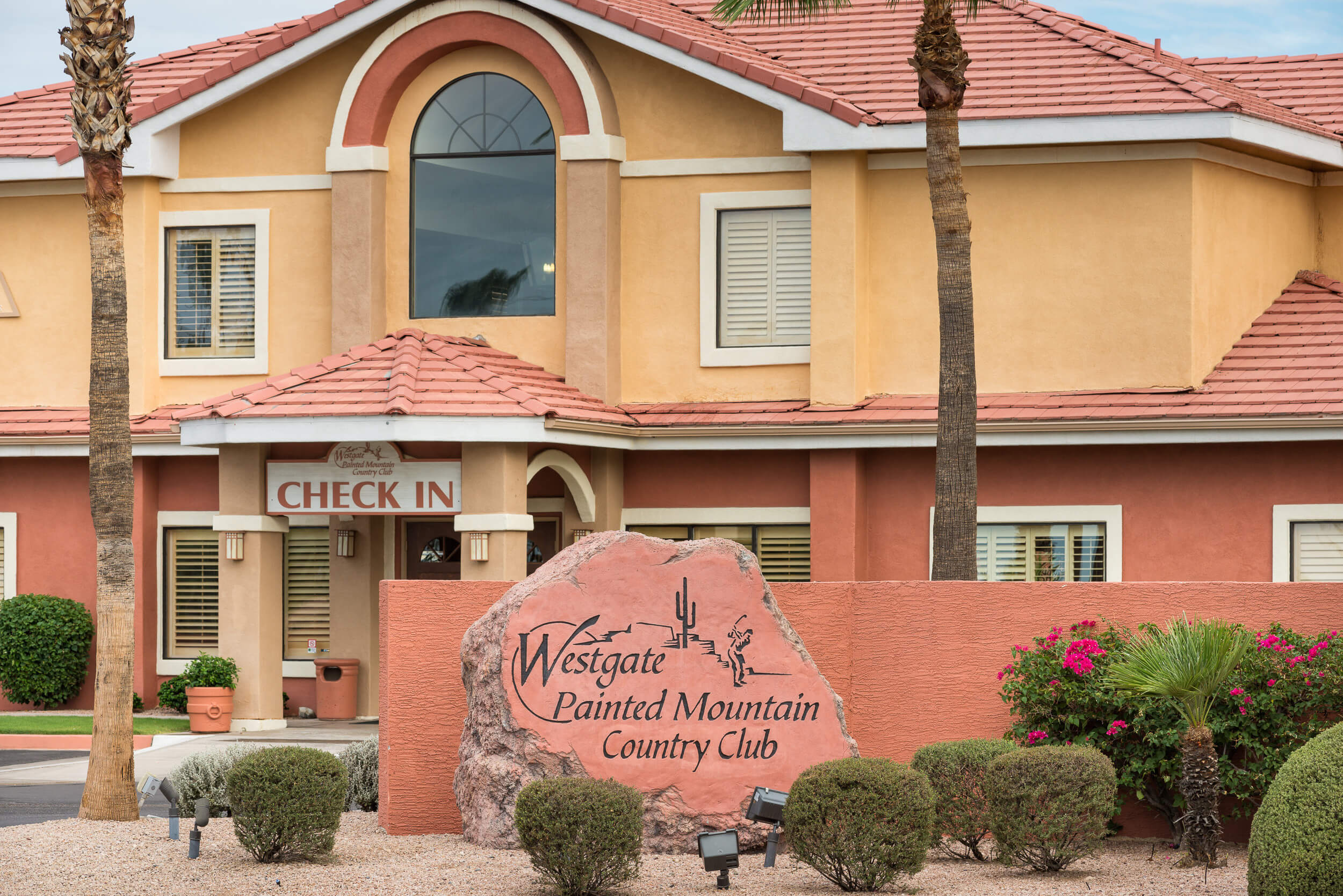 Entrance to check-in area with resort sign | Westgate Painted Mountain Golf Resort