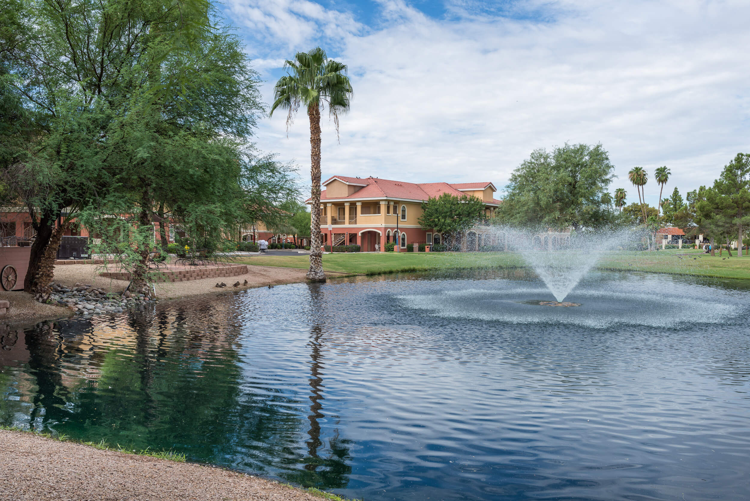 Lake with fountain with resort building in background | Westgate Painted Mountain Golf Resort