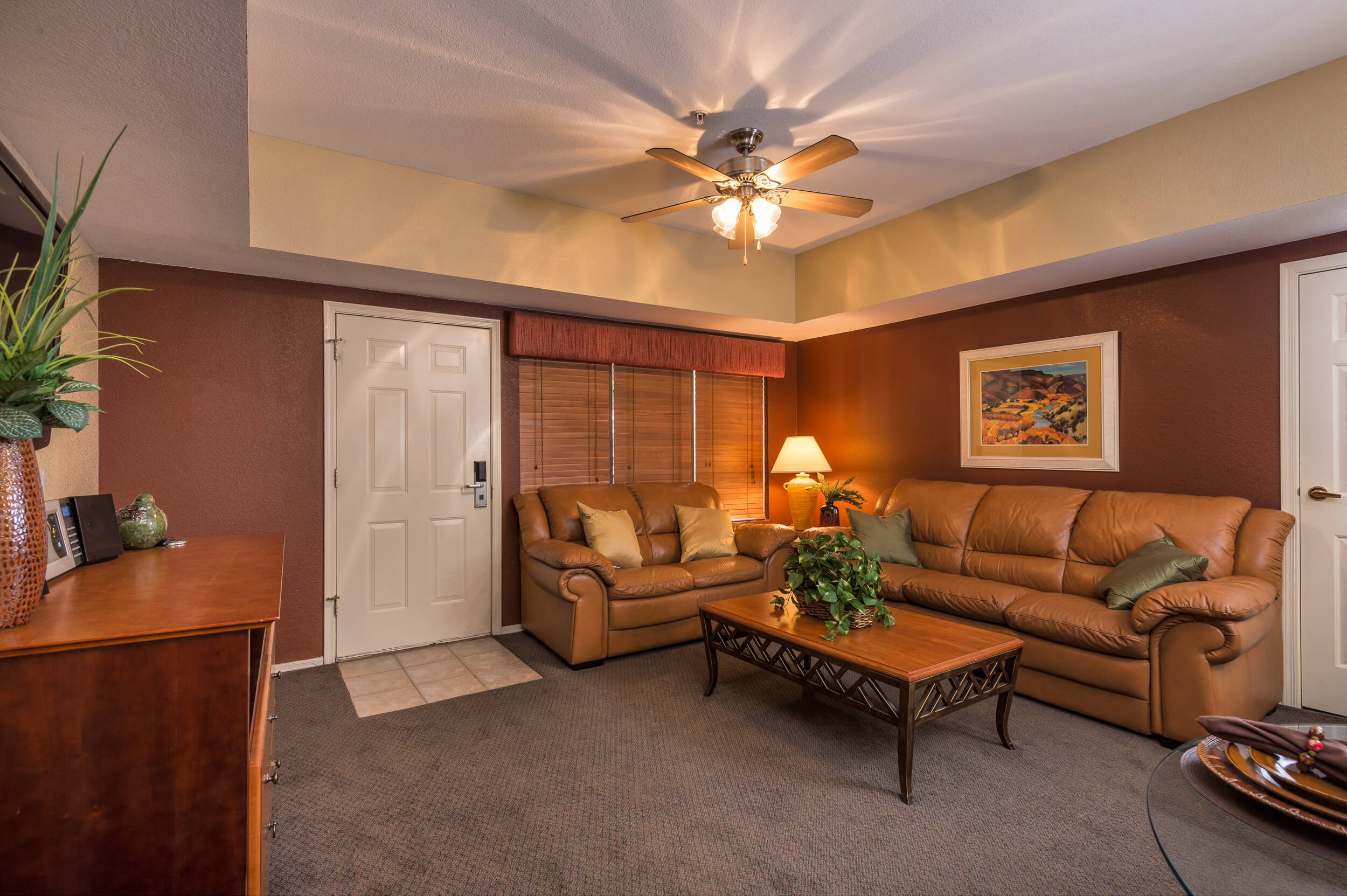Entrance to spacious villa with leather couches and ceiling fan | Westgate Painted Mountain Golf Resort