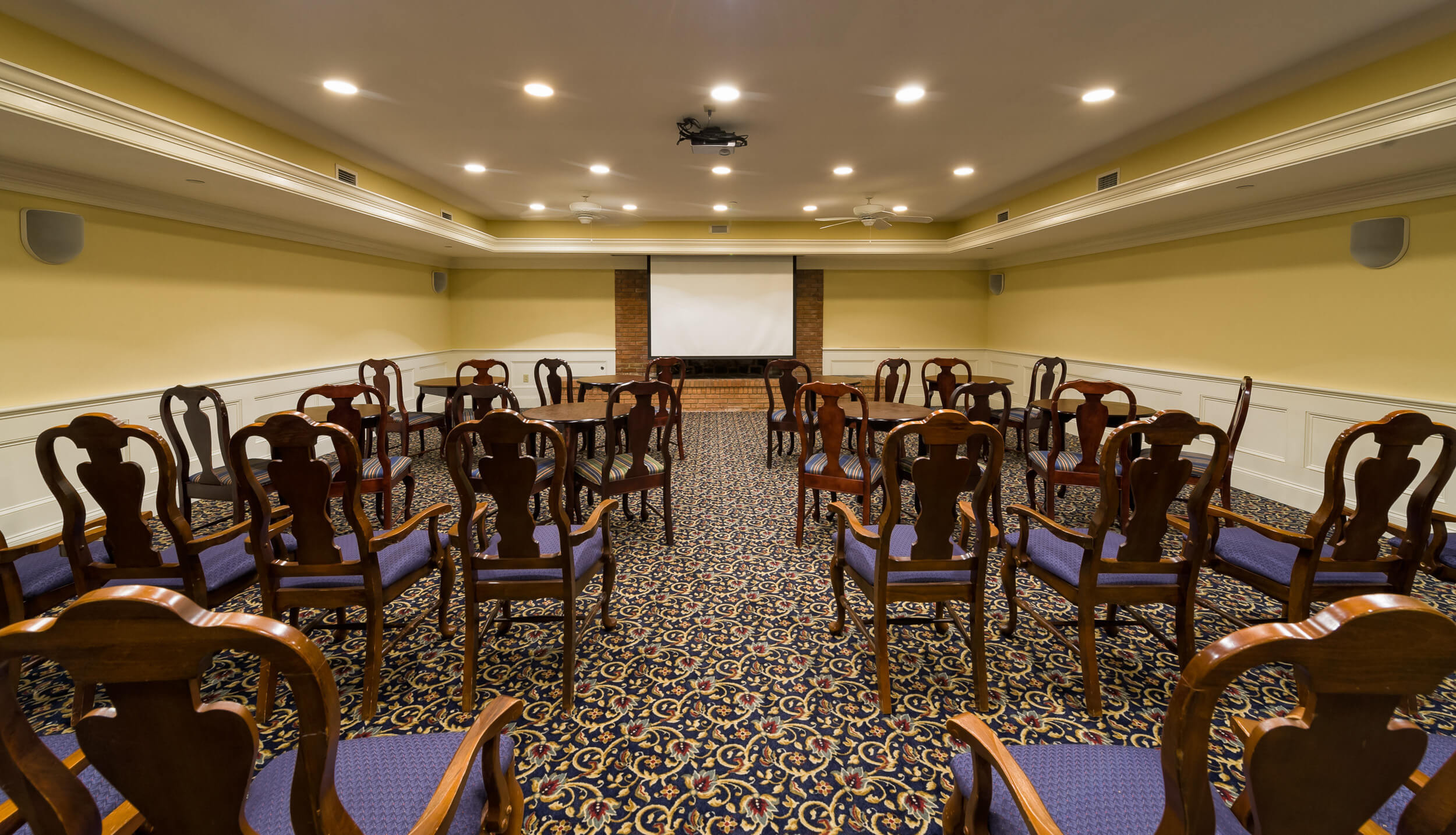Meeting room with rows of chairs and projection screen | Westgate Historic Williamsburg Resort