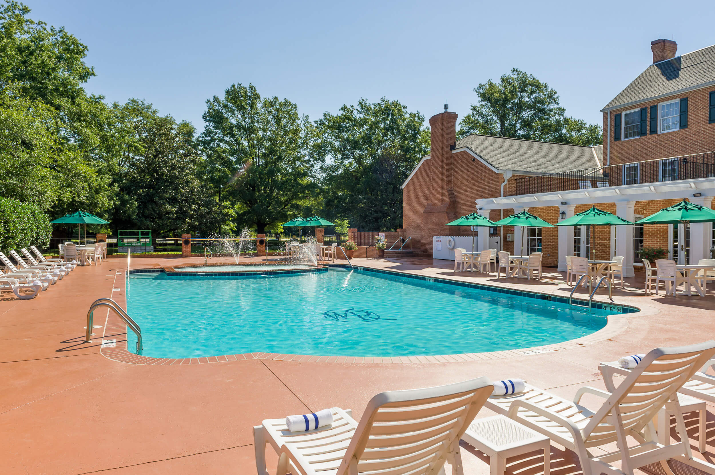 Heated outdoor pool with hot tub and lounge chairs | Westgate Historic Williamsburg Resort