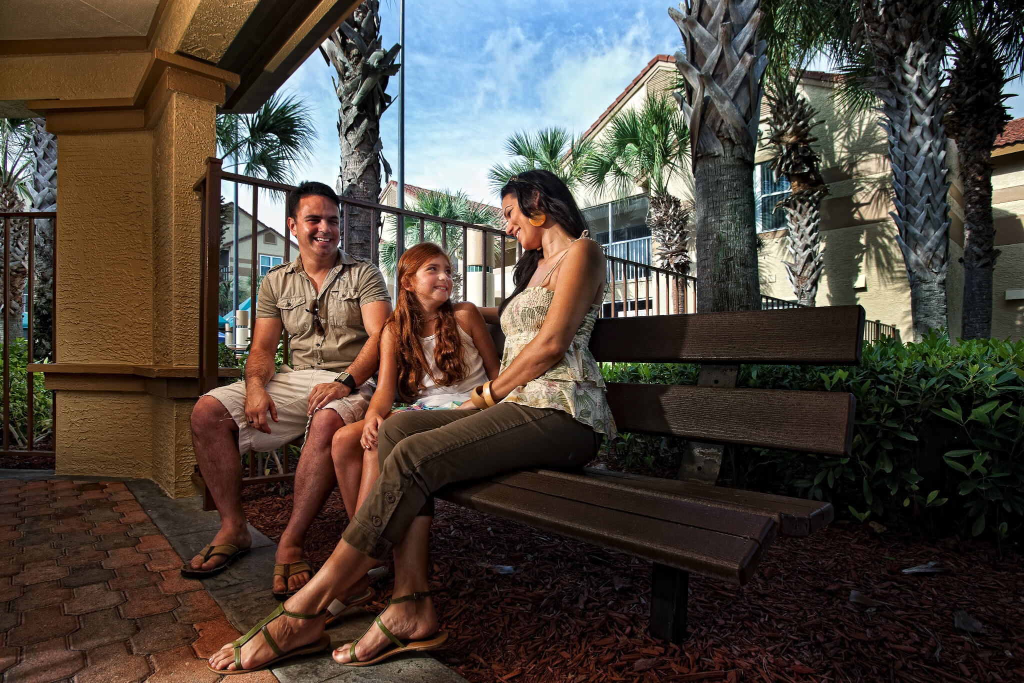 Family chilling out near pool area | Westgate Blue Tree Resort | Westgate Resorts Orlando