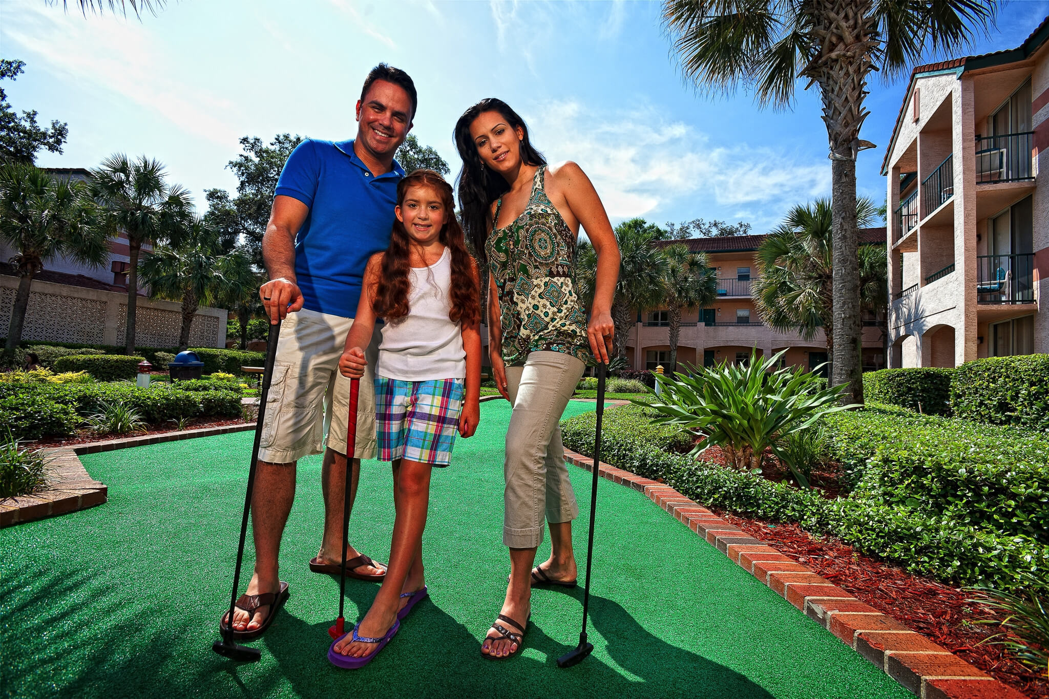 Family enjoying a round of Mini Golf | Westgate Blue Tree Resort | Westgate Resorts Orlando