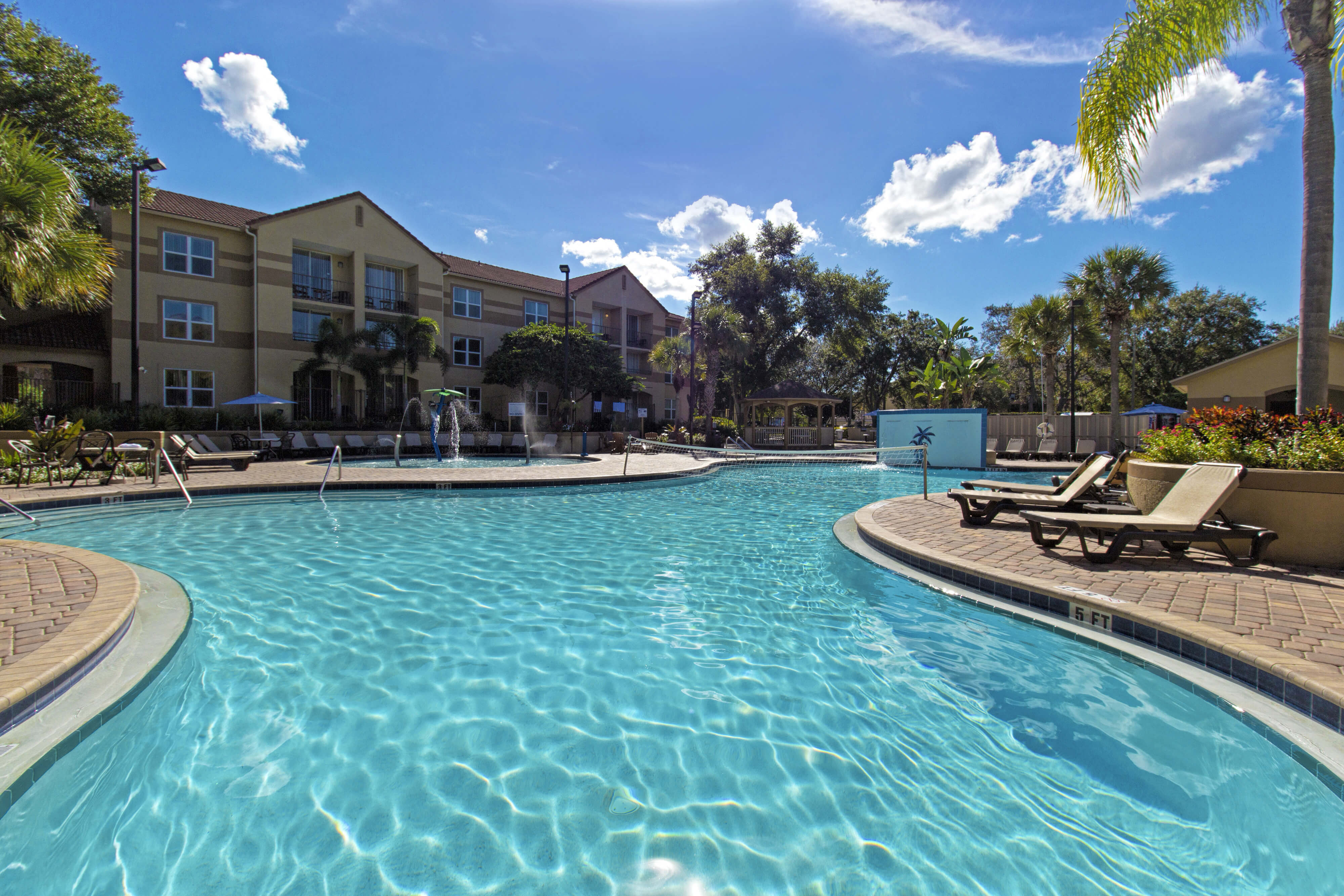 Large outdoor pool with volleyball net | Westgate Blue Tree Resort | Westgate Resorts Orlando