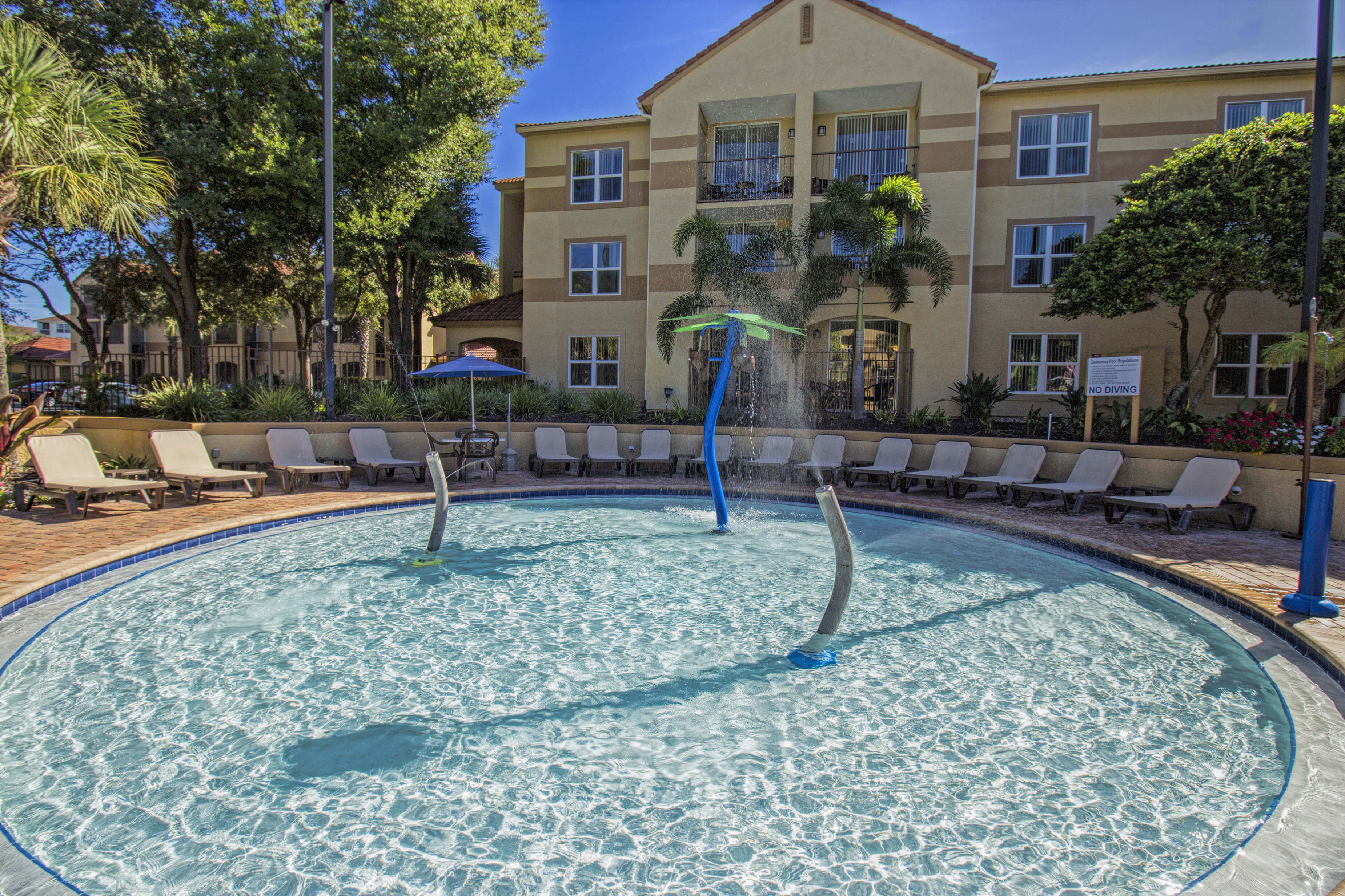 Children's water play area surrounded by lounge chairs | Westgate Blue Tree Resort