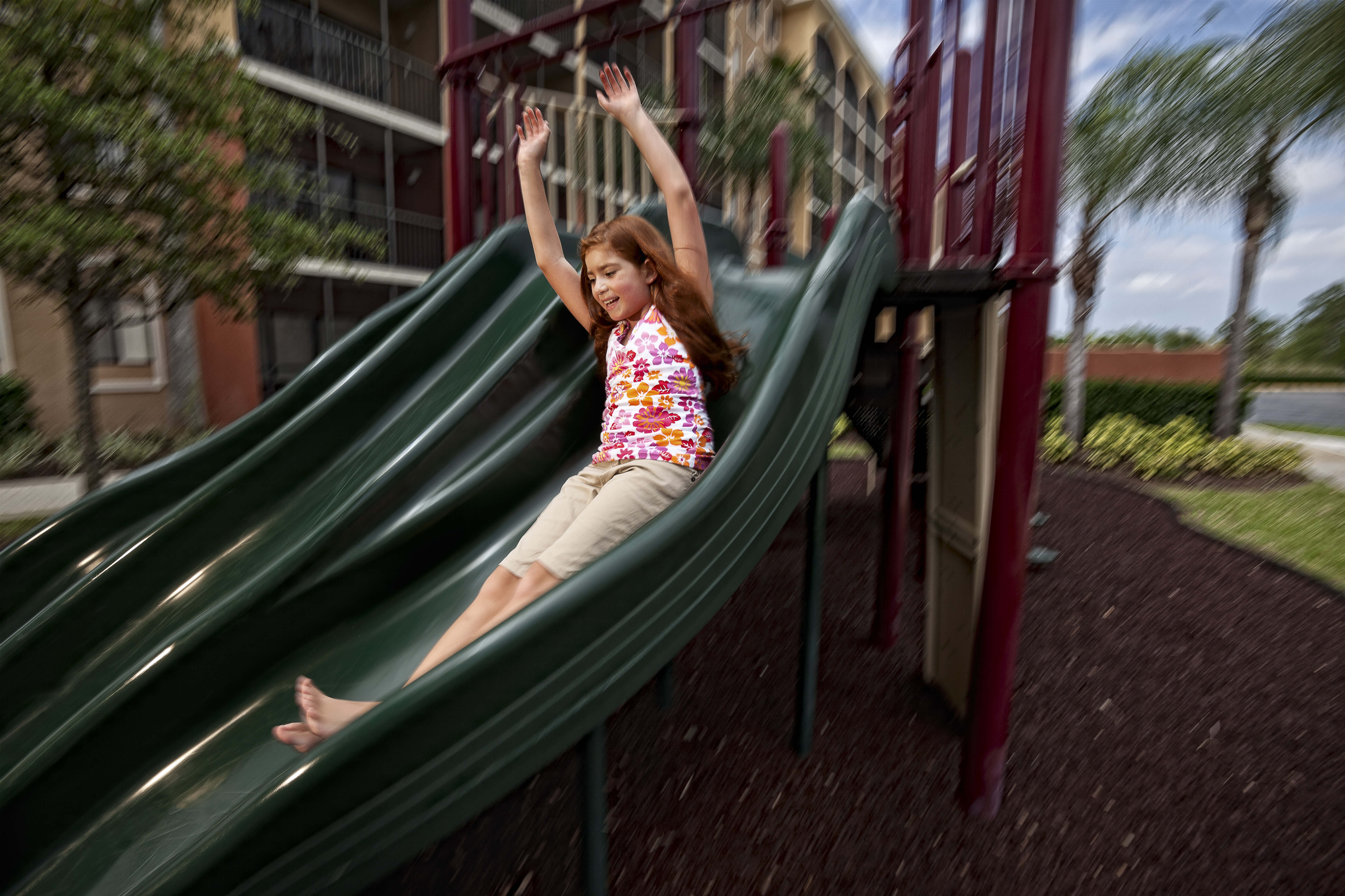 Kid on slide at Playground | Westgate Towers Resort | Westgate Resorts