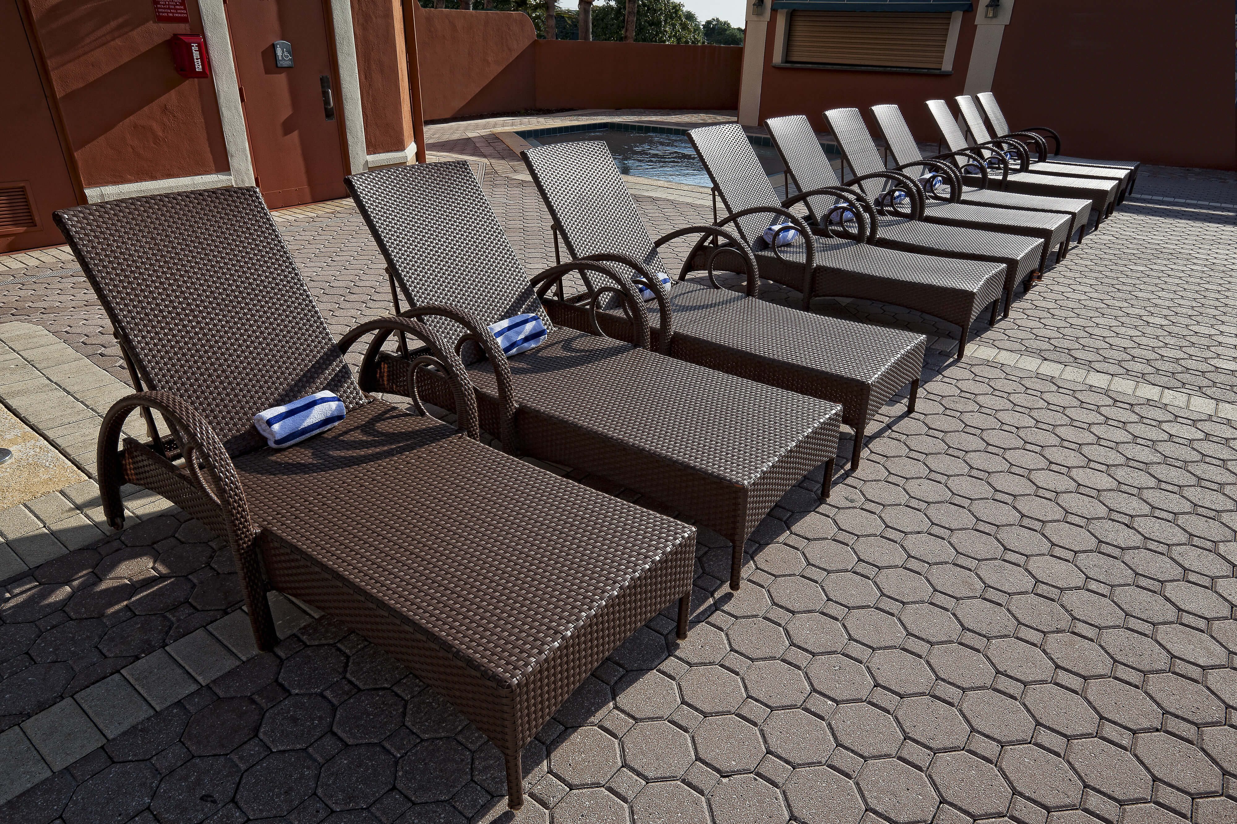 Row of lounge chairs on outdoor pool deck | Westgate Towers Resort