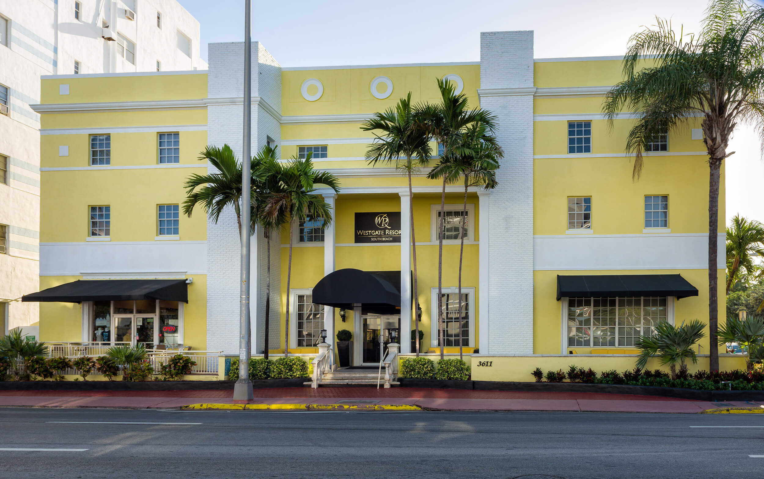 Resort exterior with palm trees at main entrance | Westgate South Beach Oceanfront Resort