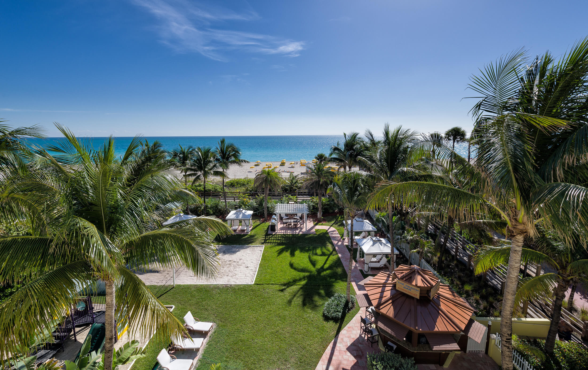 Resort grounds with volleyball court, beach bar and private cabanas | Westgate South Beach Oceanfront Resort