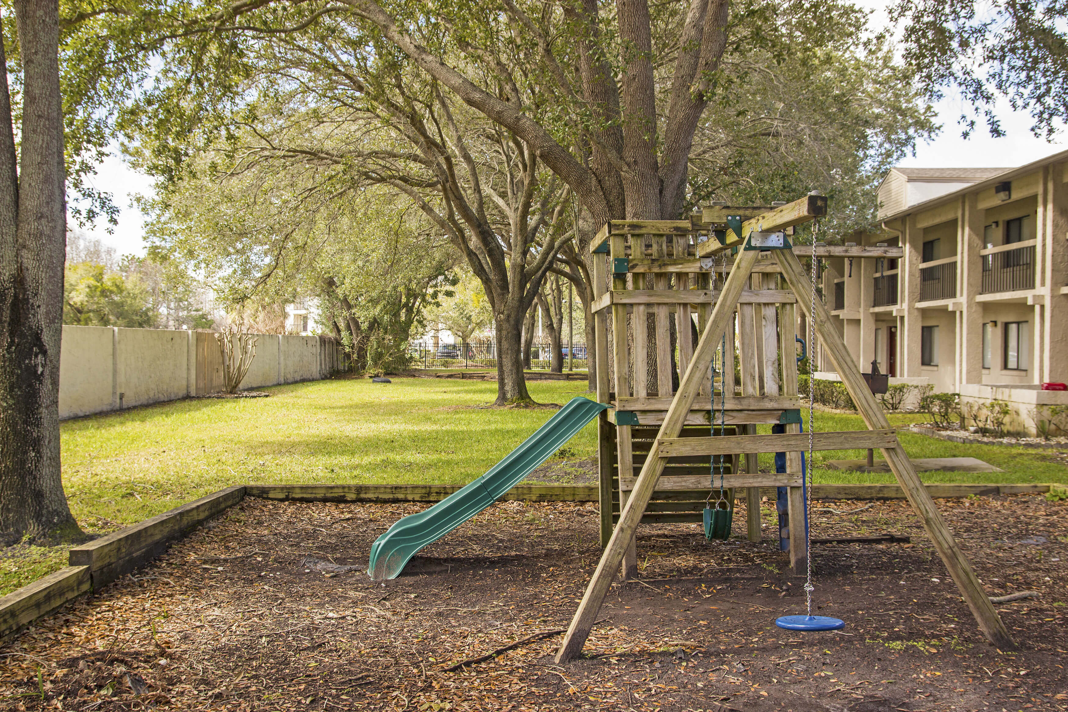 Club Orlando children's play area with plenty of space to have fun under the shade of the trees