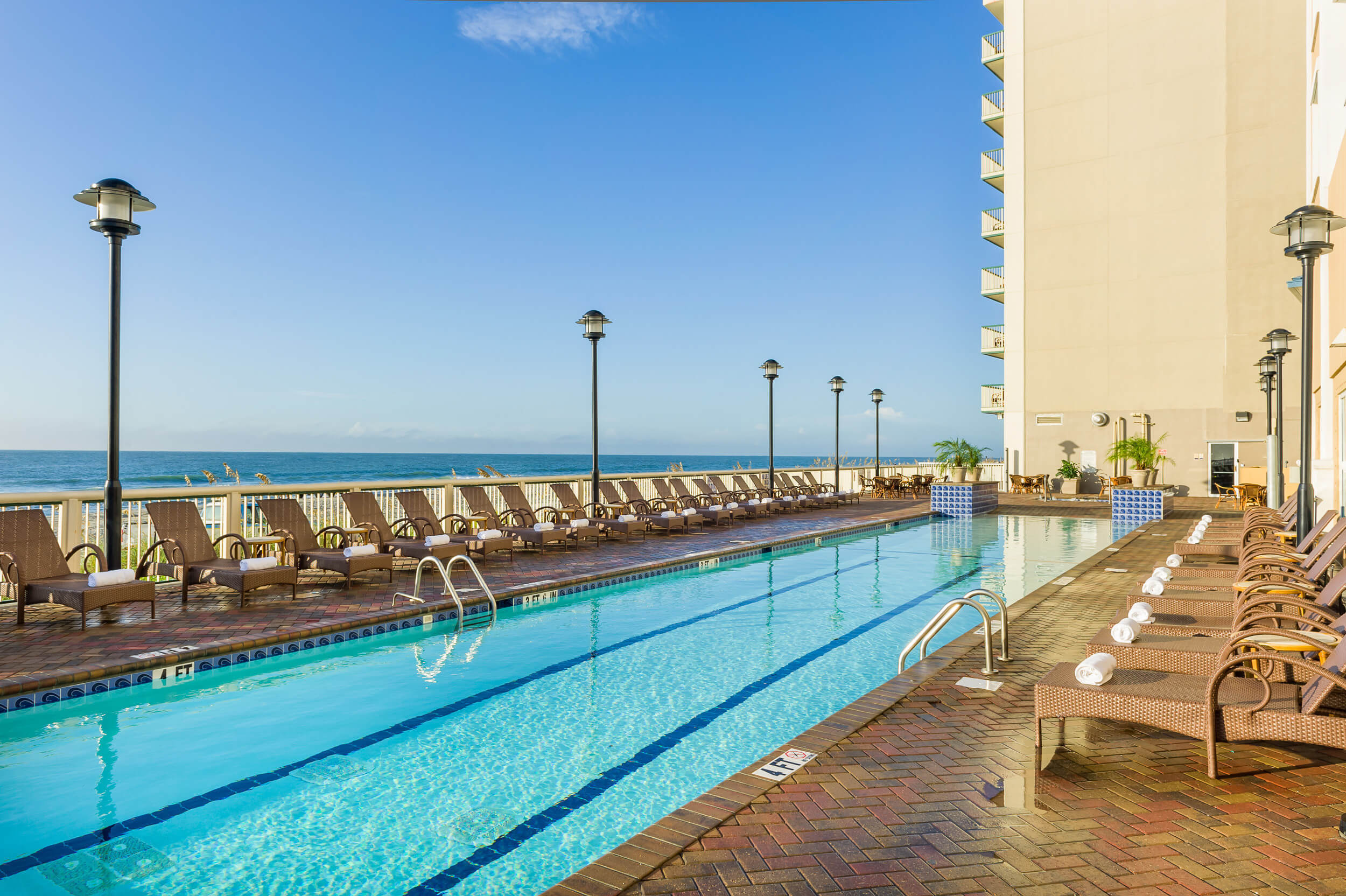 Heated outdoor pool with lounge chairs overlooking beach | Westgate Myrtle Beach Oceanfront Resort