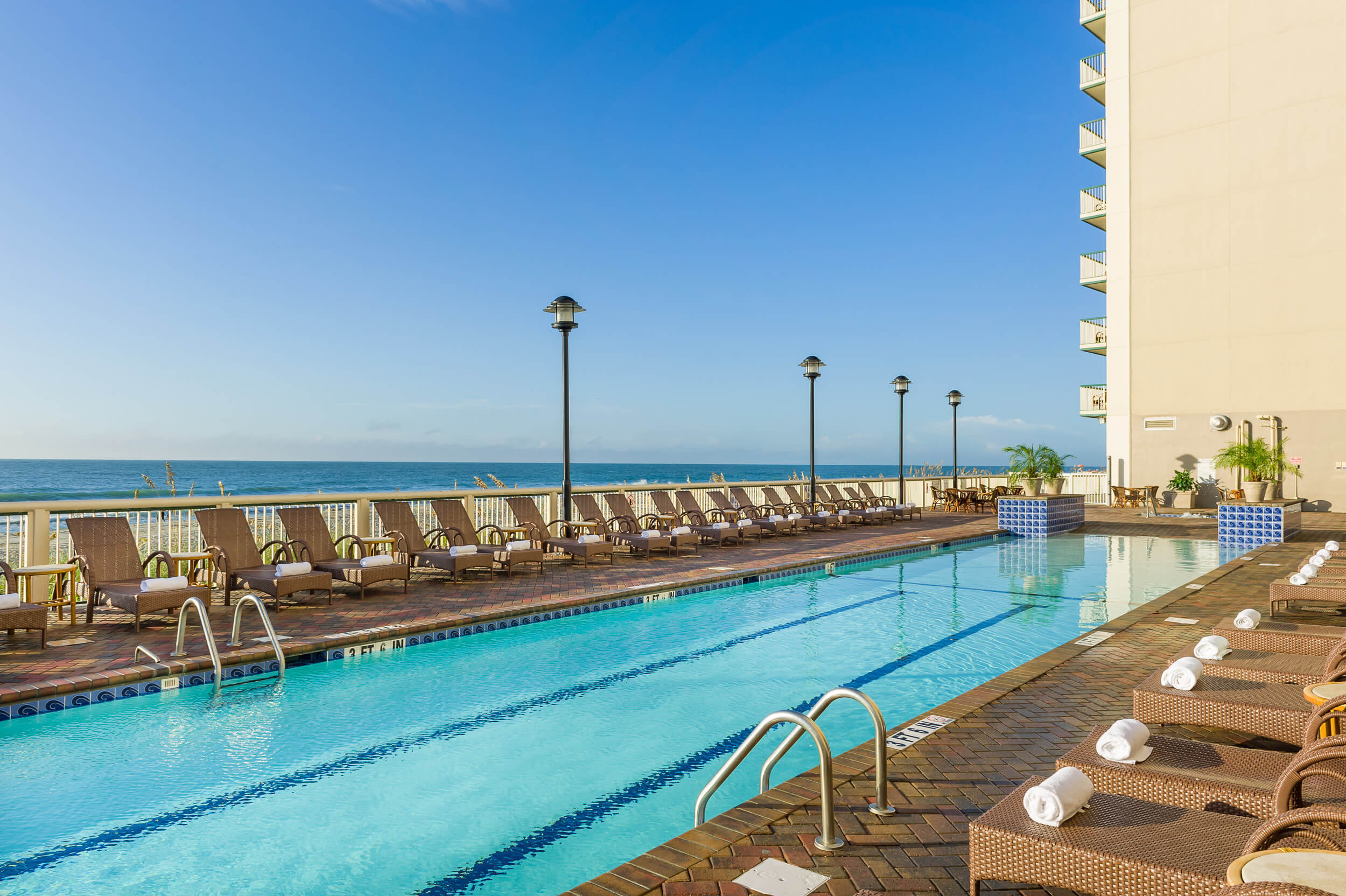 Heated outdoor pool with beach in background | Westgate Myrtle Beach Oceanfront Resort
