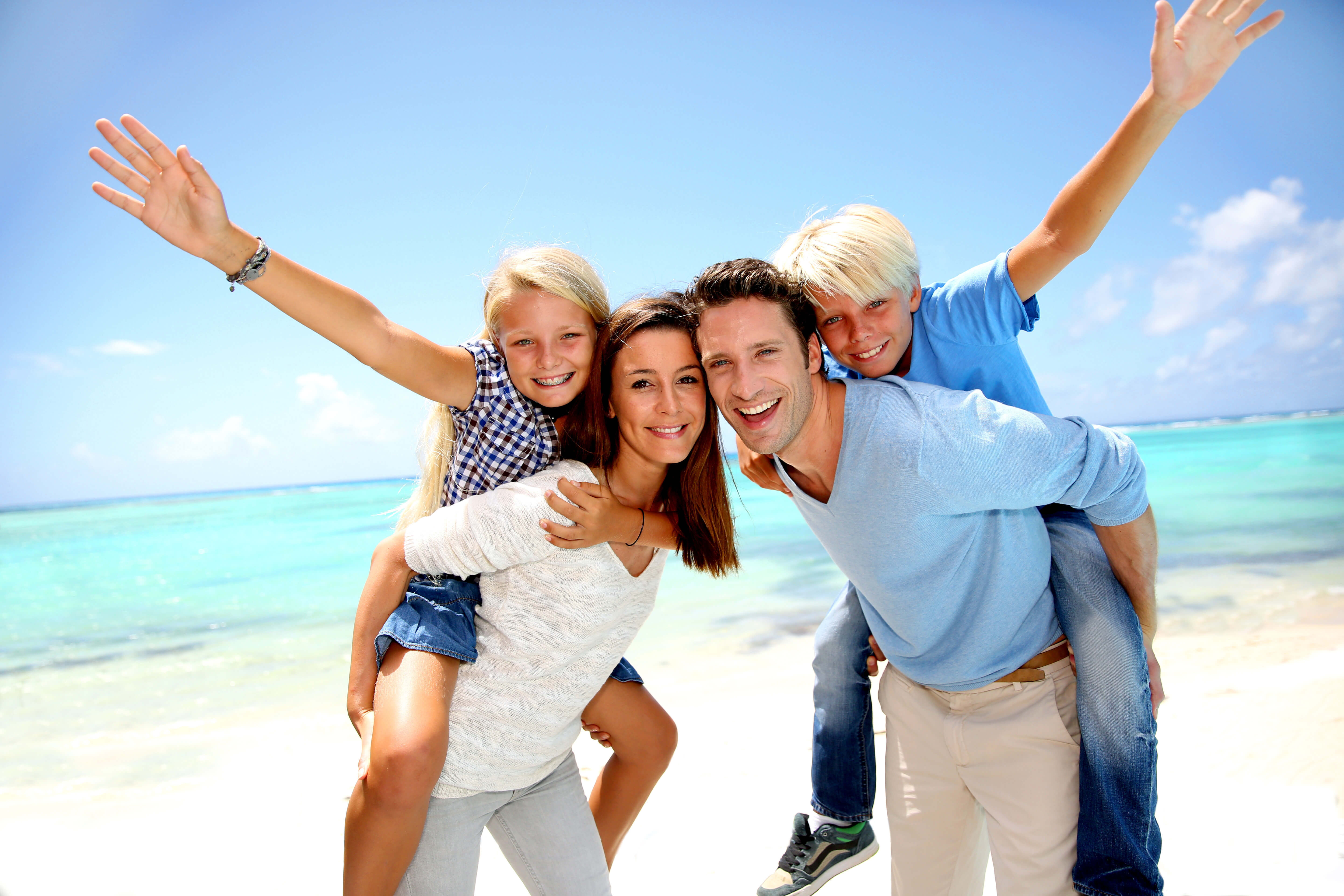 Family relaxing on white-sand beach in front of Myrtle Beach resort | Westgate Myrtle Beach Oceanfront Resort