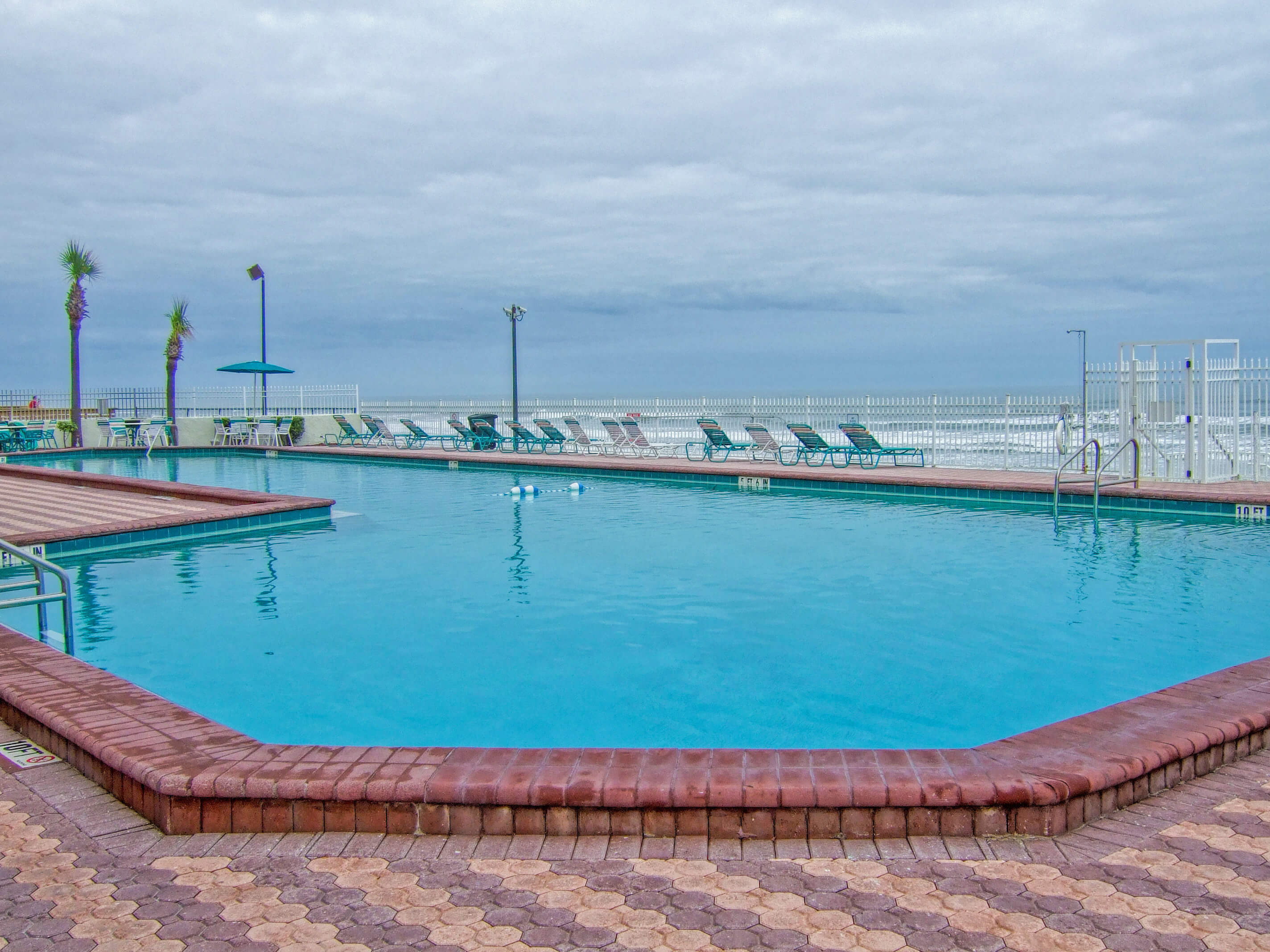 Large heated outdoor pool with lounge chairs | Harbour Beach Resort