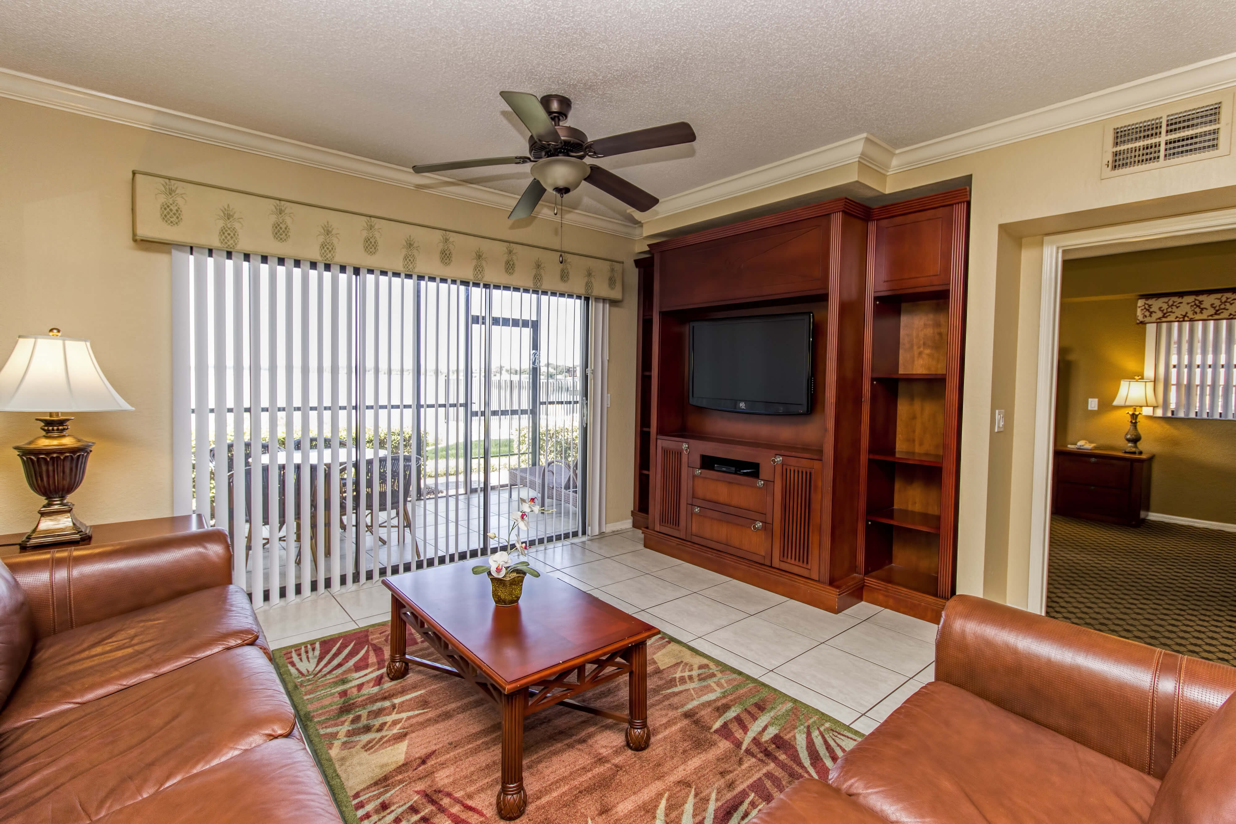 Living Room with Screened Balcony | Westgate Lakes Resort & Spa | Orlando, FL | Westgate Resorts
