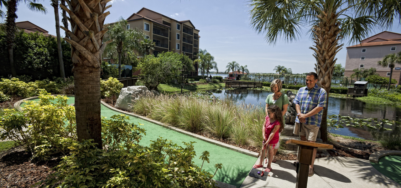 Family Playing Miniature Golf | Westgate Lakes Resort & Spa | Orlando, FL | Westgate Resorts